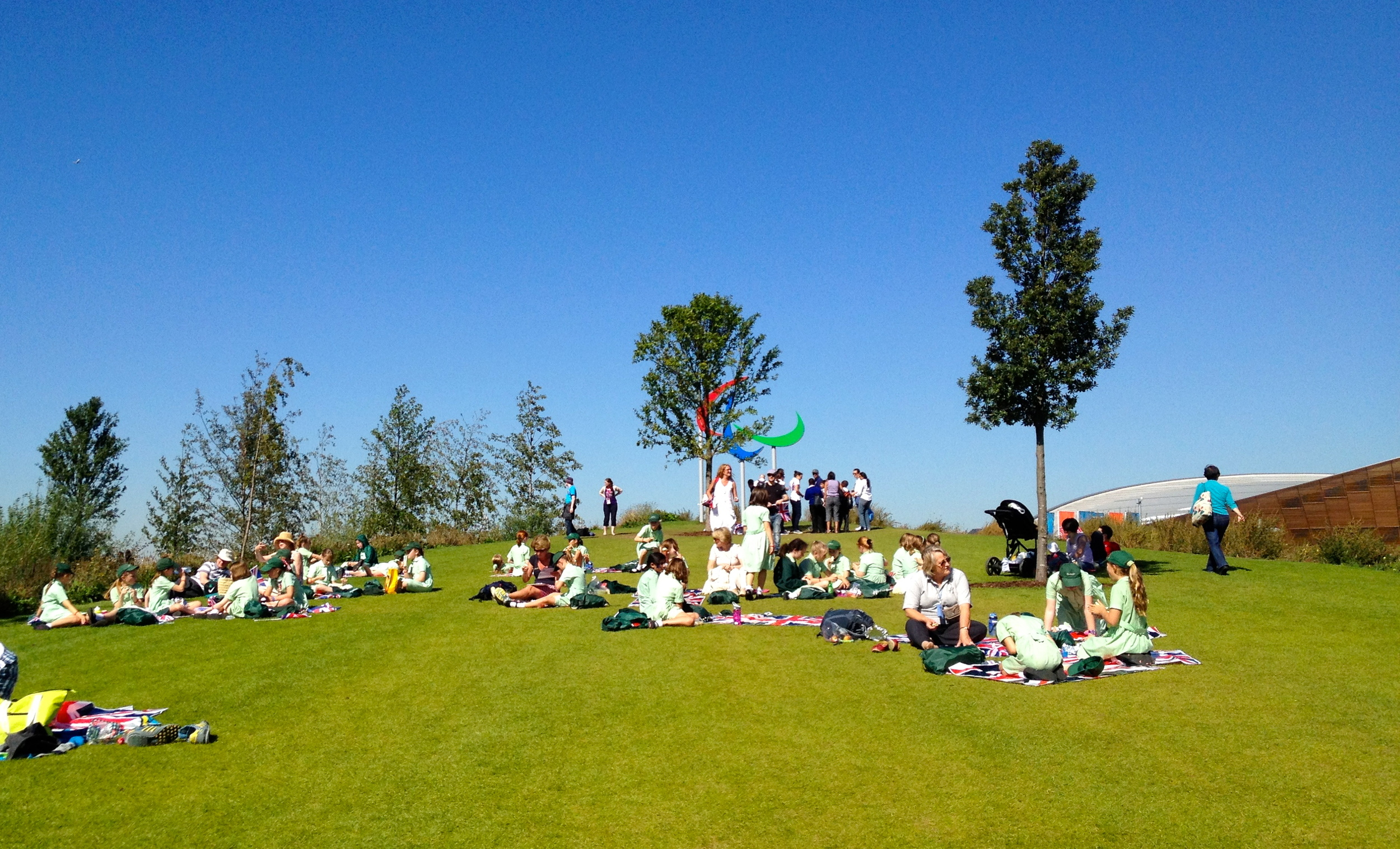 School children enjoying picnic in the Olympics Park during the 2012 London Paralympic Games.