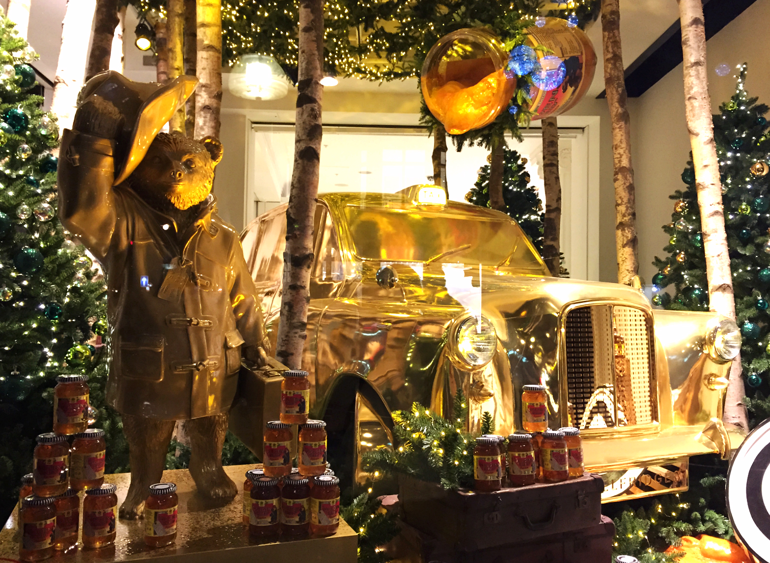 Golden Paddington Bear travels in style -- with his honey pot and taxi.  © Eileen Hsieh