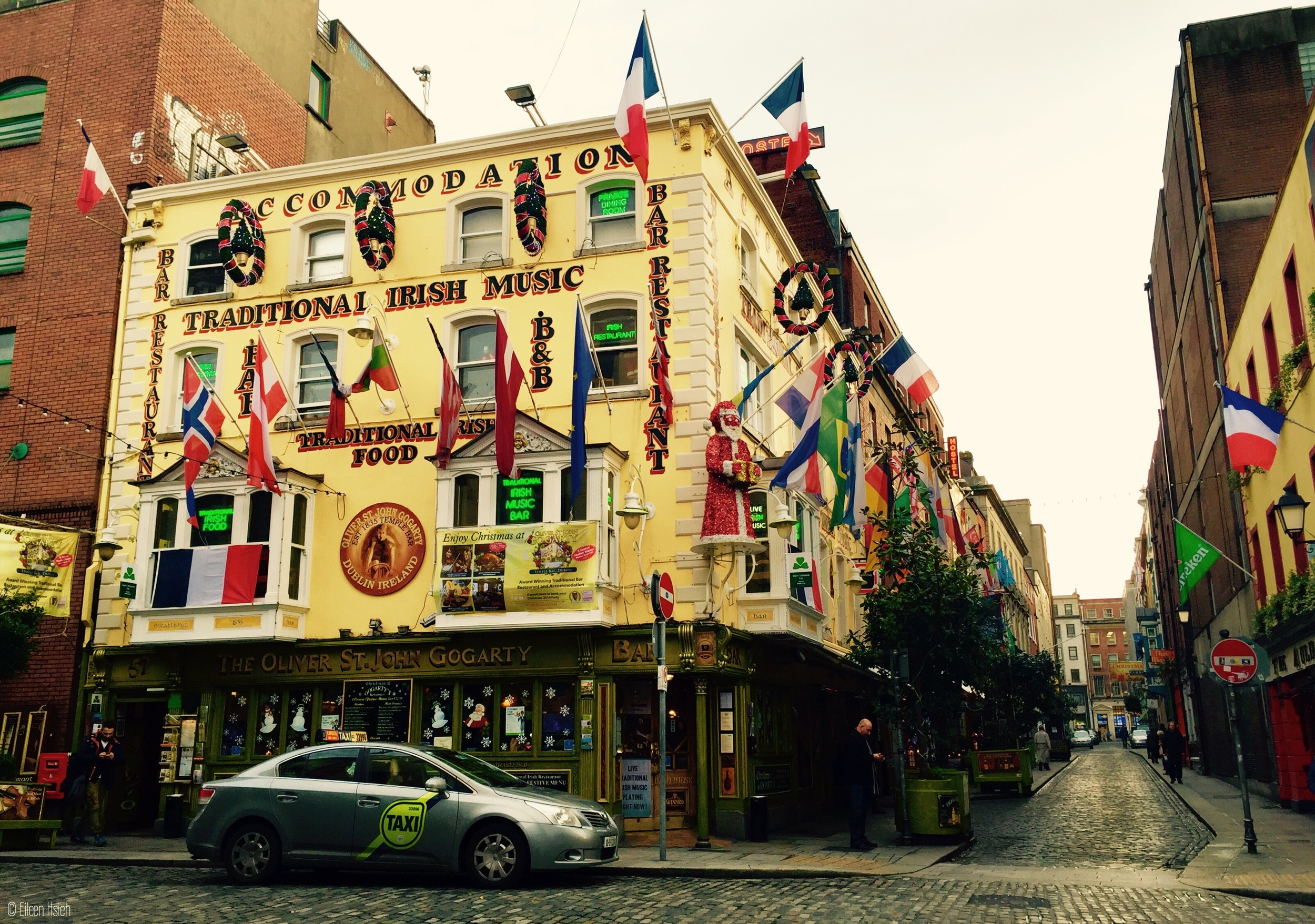 Multinational flags dominate the facade of this traditional pub in Temple Bar.