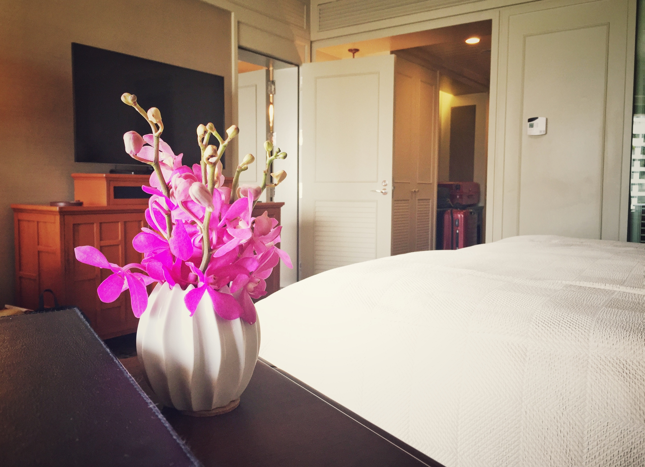 Fresh flowers and crisp linen in our comfortable deluxe room.  ©  Eileen Hsieh