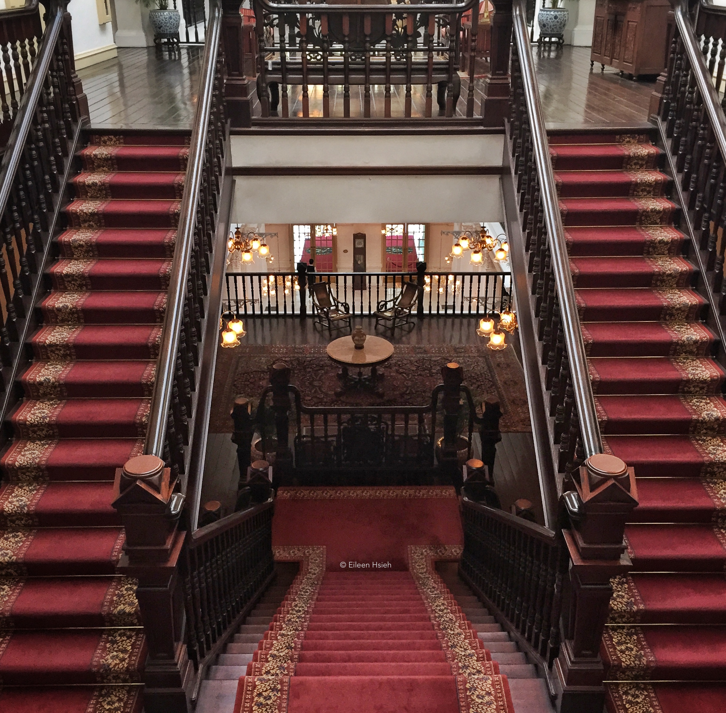 Grand stairs covered with plush oriental rugs. © Eileen Hsieh