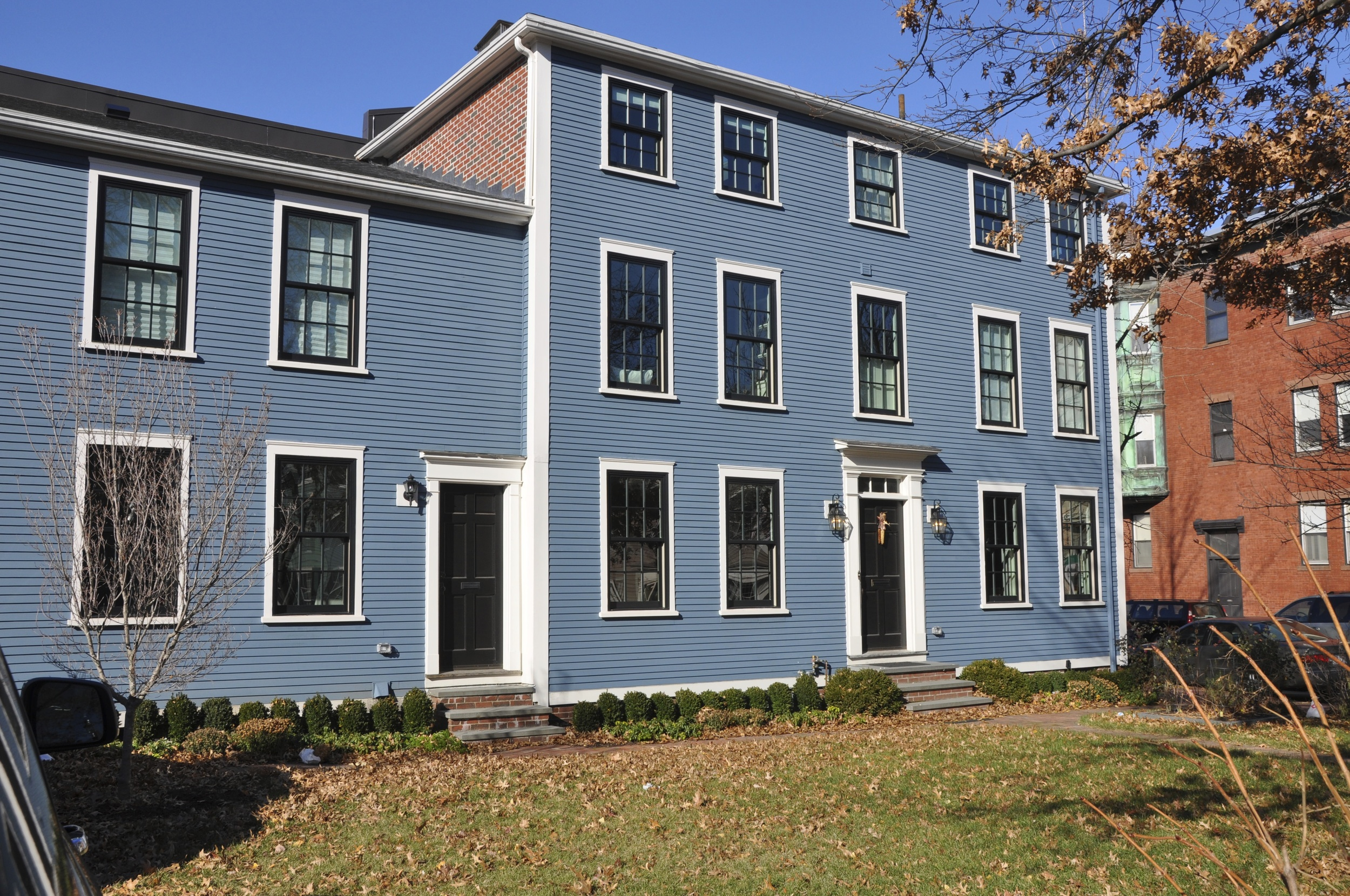 Renovation of historic residential site in Thompson Square. The two-family home was completely gutted, reducing all systems down to the bare structure. Floor systems repaired, second stairway removed, existing framing reinforced, floor plans reconfigured to form single 4-bedroom residence. Modern windows, utilities, and Icynene foam insulation contributed to energy efficiency. Finishes include custom wainscoting, pilasters, built-in cabinetry, and historic trim profiles throughout. With Justin Kelly Contracting.