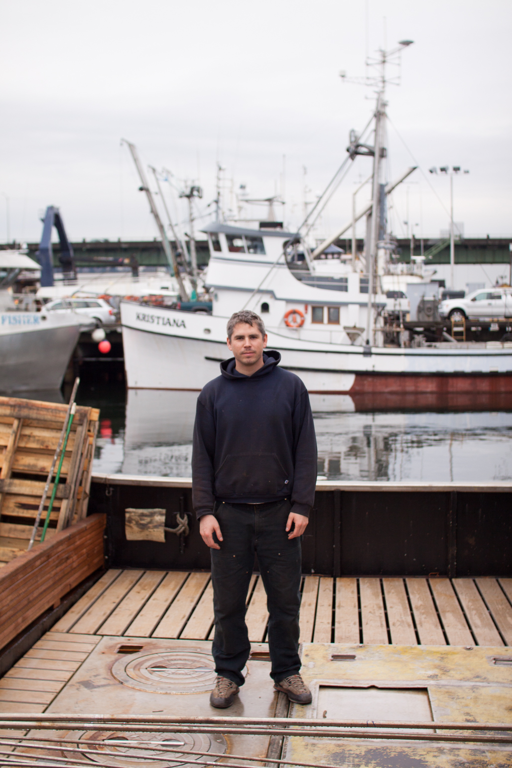 Sean, a crew member on a southeastern Alaskan salmon seiner, aboard his vessel in Fishermen's Terminal. A native of Seattle, Sean spends a large part of his summer in the north Pacific fishing for what many call Red Gold. Seattle Washington
