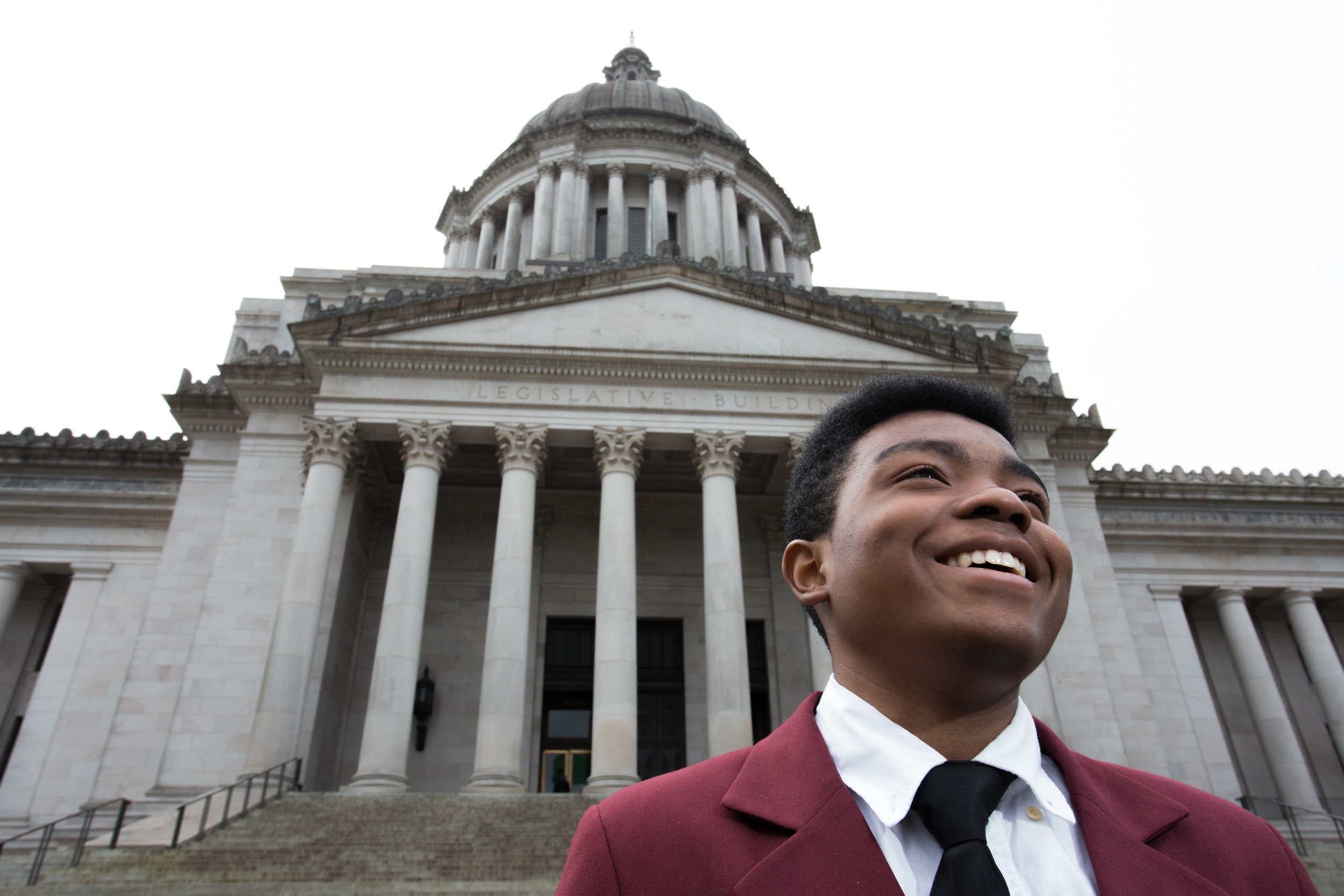 Marcelas Owens, a Page for Washington State Senator Pramila Jayapal. Owens has been a health advocate since the age of 10, after his mother passed away and stood behind President Obama when he signed the Affordable Care Act.