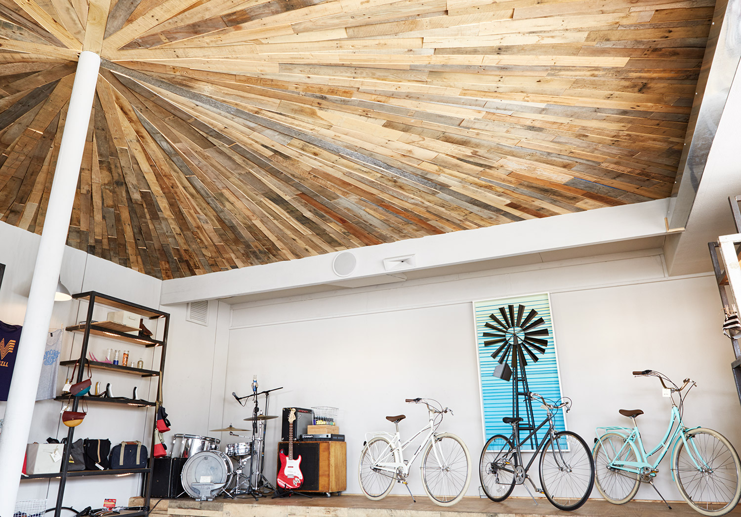 When Sarah and Aaron were building out the shop, Sarah drove all over town collecting old pallets and they created this cool ceiling out of the materials.