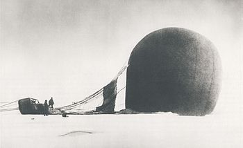 S. A. Andrée and Knut Frænkel with the crashed balloon on the pack ice, photographed by the third expedition member, Nils Strindberg. The exposed film for this photograph and others from the failed 1897 expedition was recovered in 1930.