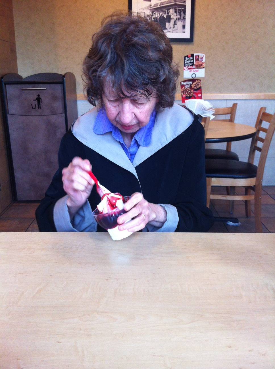 joanne cave's mother enjoying an ice cream sundae with her daughter, on a rare afternoon out of long-term care.