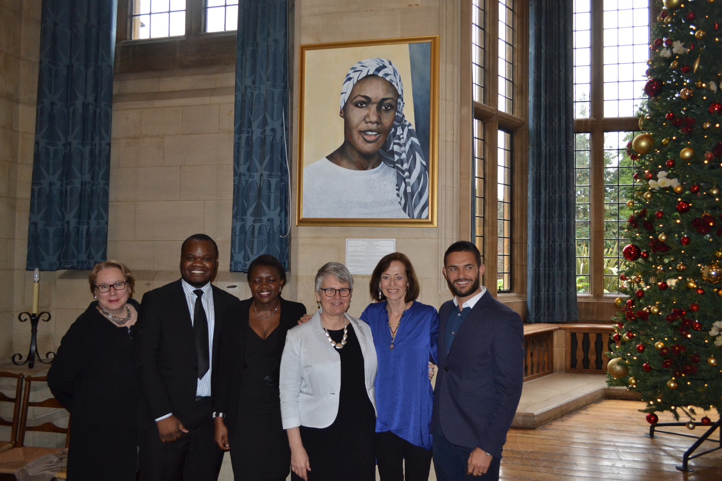 Left to right: Ann Olivarius (Chair of the Rhodes Project and a donor to the portrait project); Kabeleka Kabeleka and Karen Mumba (Members of the Black Rhodes Scholars Association); Susan Rudy (Executive Director of the Rhodes Project); Deirdre Saunder (a Rhodes Scholar and the artist who created the portrait); and Tony Abrahams (a Rhodes Scholar and donor to the portrait project).