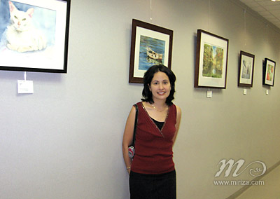 Michelle with some of her paintings at the School District of Palm Beach County.