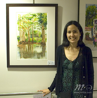 Michelle with one of her paintings at the Museum.