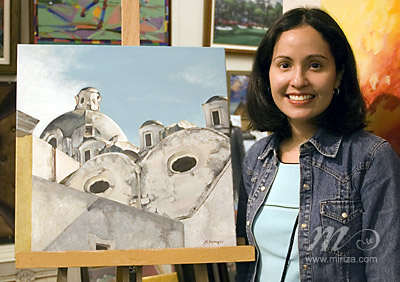 Michelle with her painting at the Exhibit.