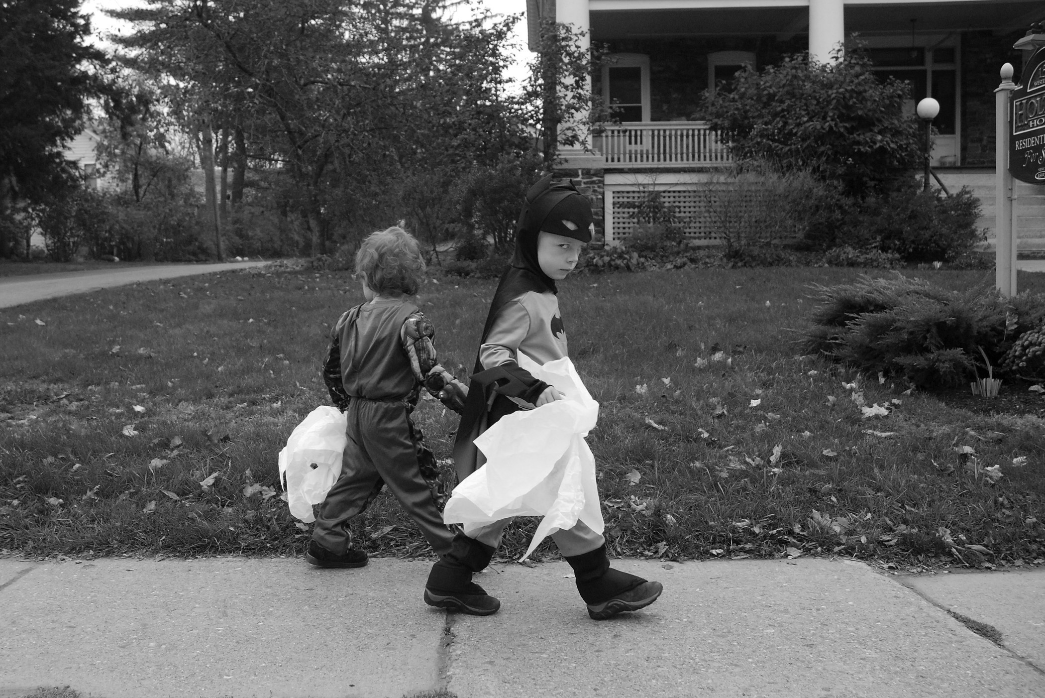 A child dressed as Batman gives the superhero's signature stare while walking with classmates from Neighborhood Schoolhouse in Brattleboro, Vt. after spending time visiting a nursing home on Halloween.