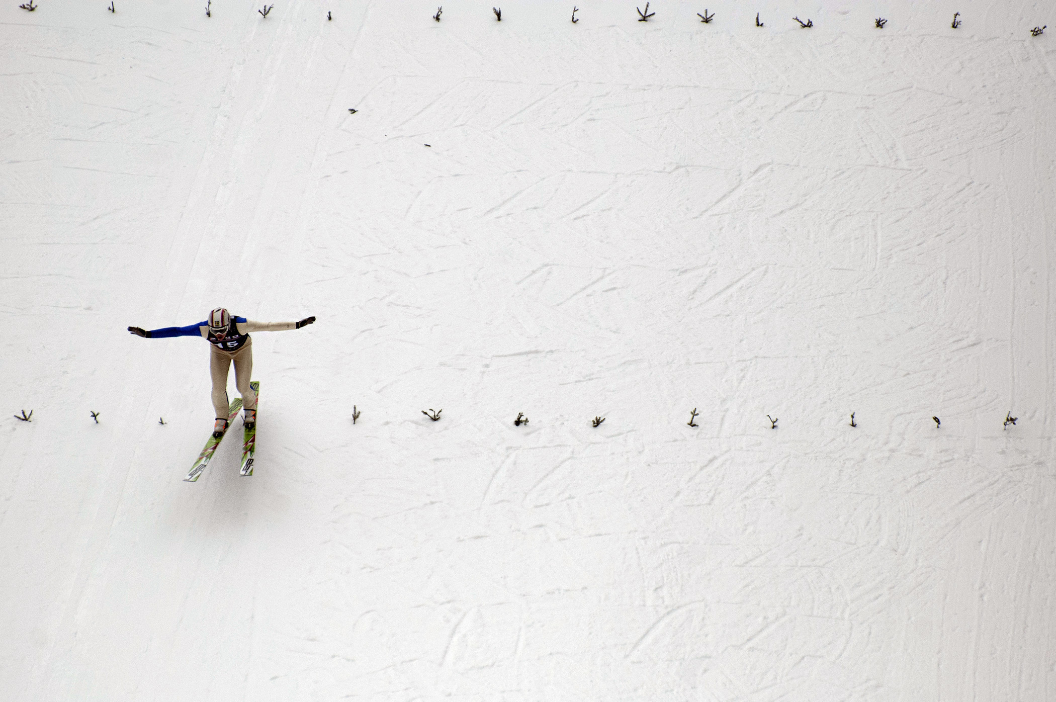 Ski jumper Erik Gundersson of Sweden prepares to land during a jump at the Harris Hill ski jumping competition on Feb. 15, 2014.