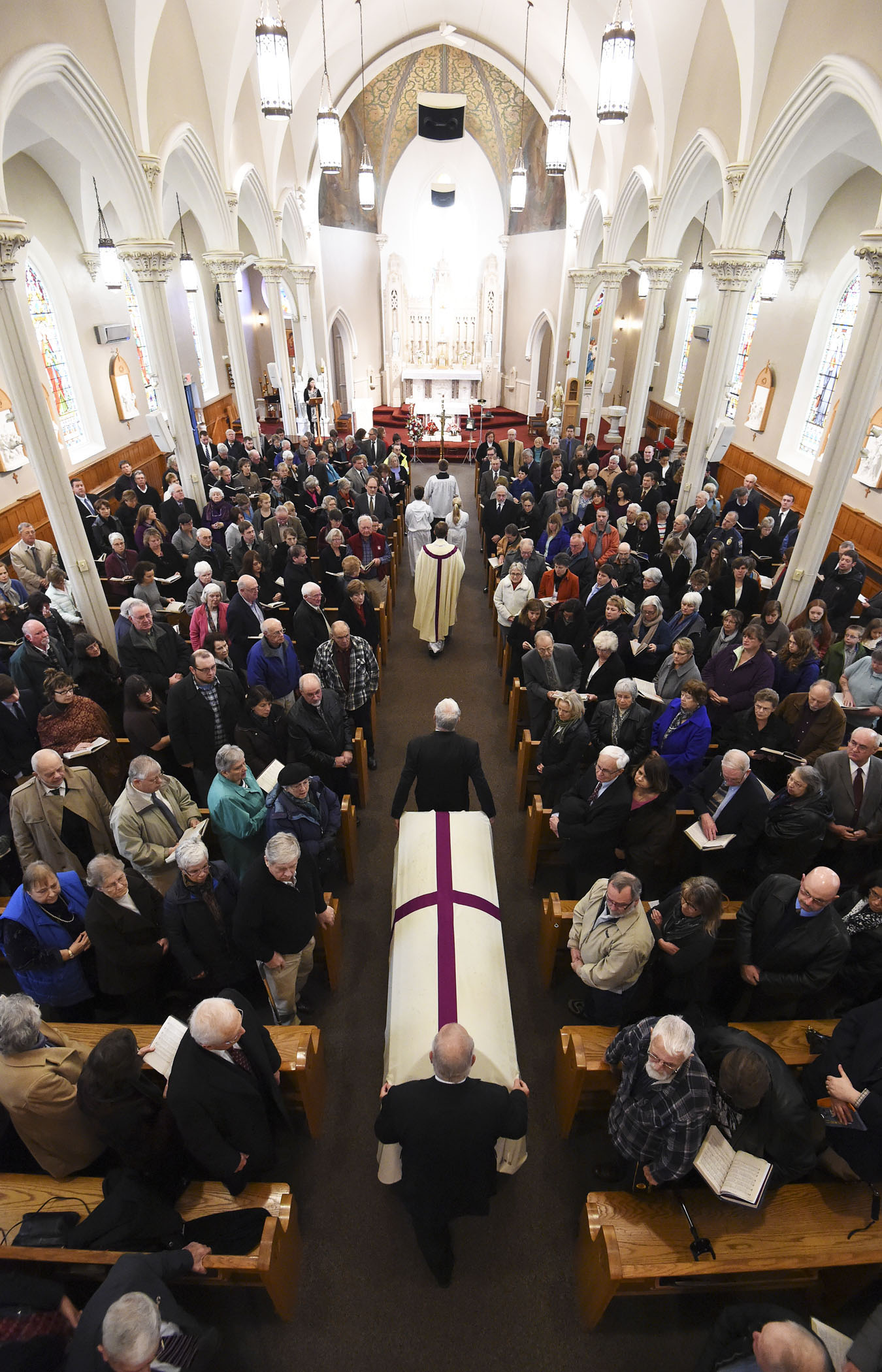 The casket carrying the body of former Brattleboro Police Chief Richard Guthrie is carried into St. Michael Catholic Church in Brattleboro, VT during a funeral service for Guthrie on Nov. 22, 2014.