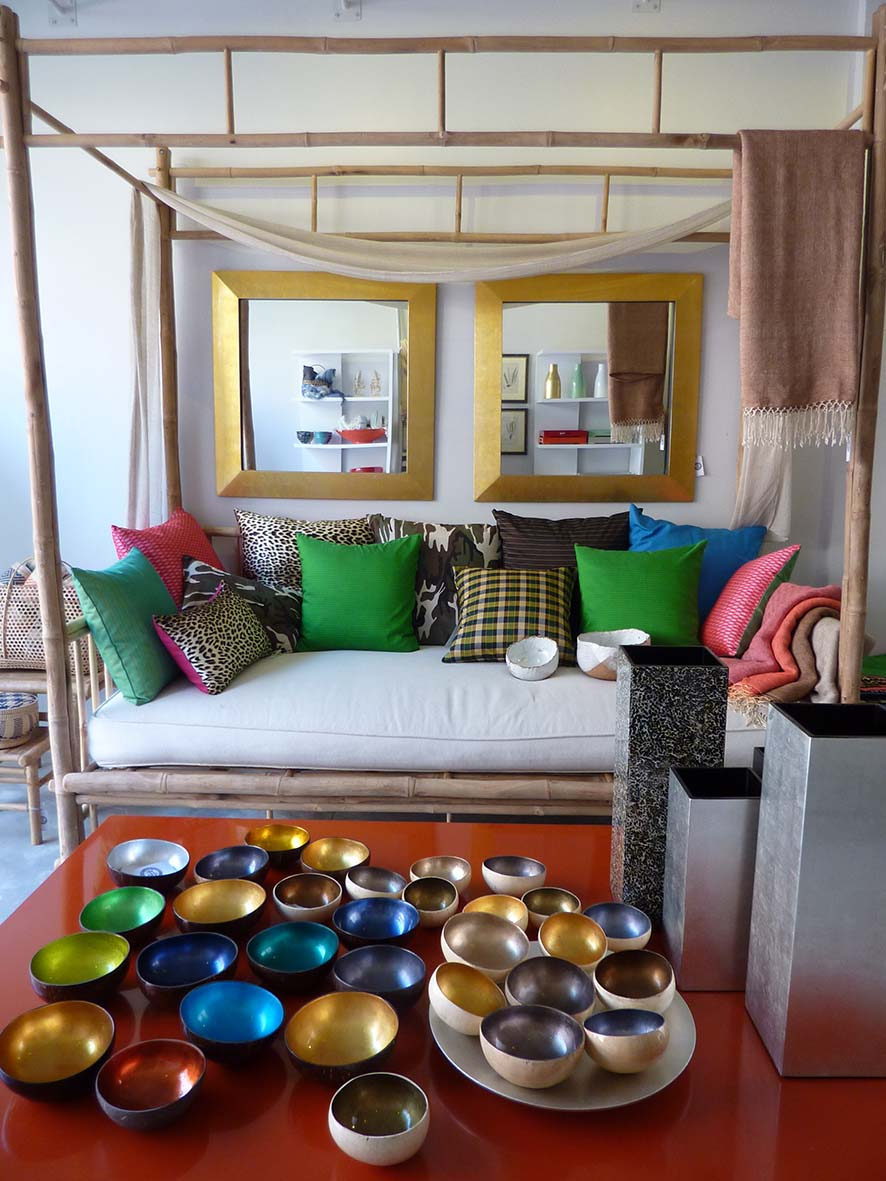 A colourful collection of handwoven Cambodian silk cushions, rustic chic ceramic bowls, coconut lacquer bowls and vases.