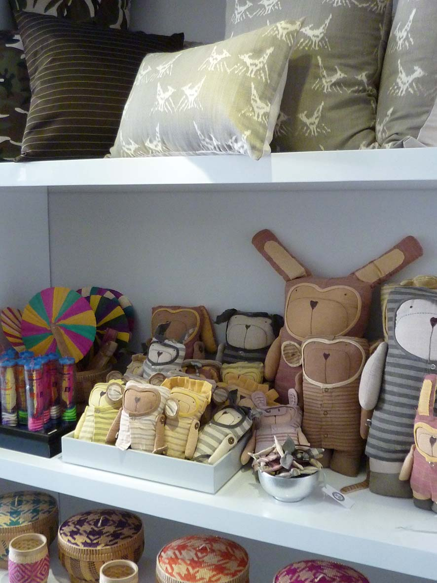 A collection of 100% cotton collectible animal dolls, local shuttlecock toys, colourful handwoven bamboo baskets and modern handwoven silk/cotton ikat cushions.