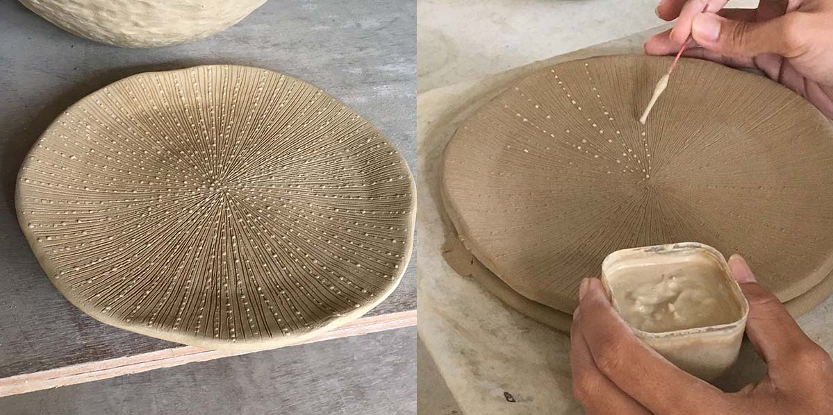 A lot of work and skill goes into making each and every single piece from our new ceramic coral collection. Here a talented craftsman is adding the subtle details that gives the coral plate it's unique look, no two plates are the same.