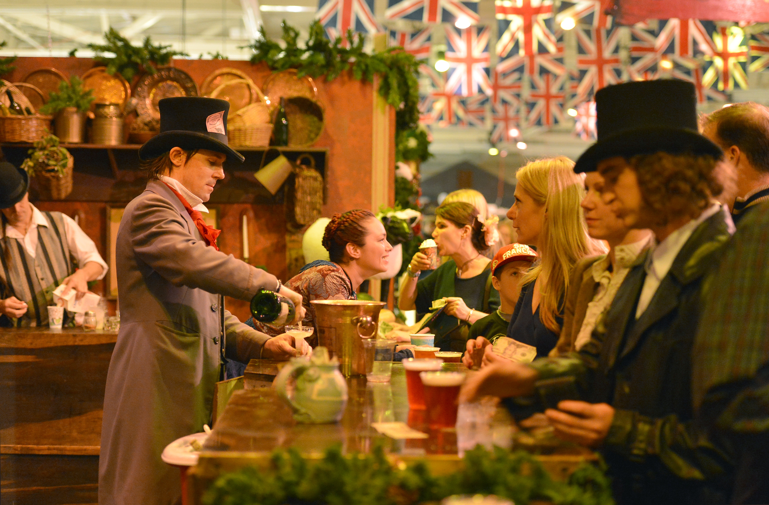Four authentic English pubs - and the Bohemian Absinthe Bar - serve up hearty Christmas cheer at the Great Dickens Christmas Fair.    Photo credit: Rich Yee