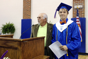 Sawyer L. Locke, from Northwest Whitfield High School, was awarded a scholarship by Georgia SWANA board member emeritus Mack Belue during Senior Recognition Day.