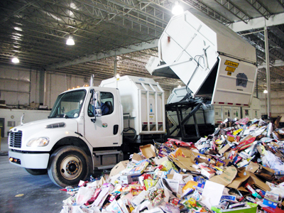 A load of mixed paper is dropped off at the Recycling Center by a City of Dalton Curbside Recycling truck. Mixed paper is recycled to make a variety of goods that range from restaurant napkins to paperboard boxes for pre-packaged food.