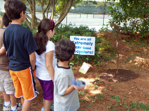 Campers see their group's tree for the first time. The Dalton Tree Board donated a Japanese Maple Red Dragon and planted it along the walking track near the tennis courts at the Bradley Wellness Center.