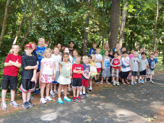 Pictured are the BWC June campers next to their new tree. Together they collected over 250 plastic bottles for recycling during their four-day camp.