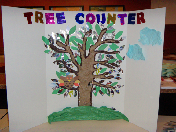 Pictured is the Tree Counter poster that the campers used to keep track of their recycling. Each leaf represents one plastic bottle. They exceeded their goal of collecting 100 plastic bottles during the four-day camp in June.