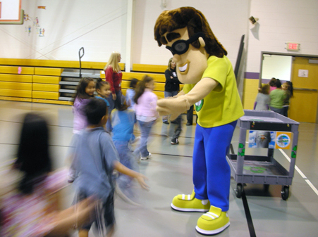 Mascot Recycling Ben congratulates students at Dawnville Elementary School for winning a recycling award.