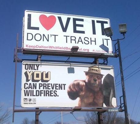 """One of the billboards for the new """"Love it, don't trash it!"""" anti-litter campaign is located at S. Thornton Ave. and Cedar St. in Dalton."""