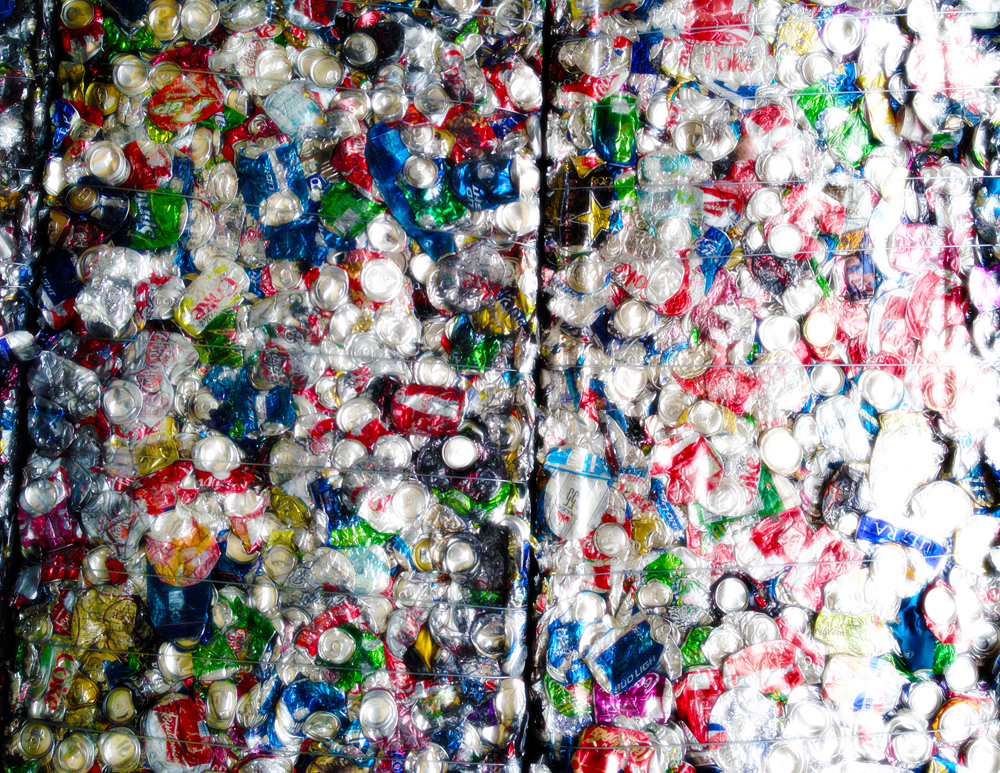 The recycling process for an aluminum beverage can takes as little as sixty days. Recycling one can saves the energy required to run a television set for three hours. Pictured is a bale of cans ready to be sent to a manufacture for processing.