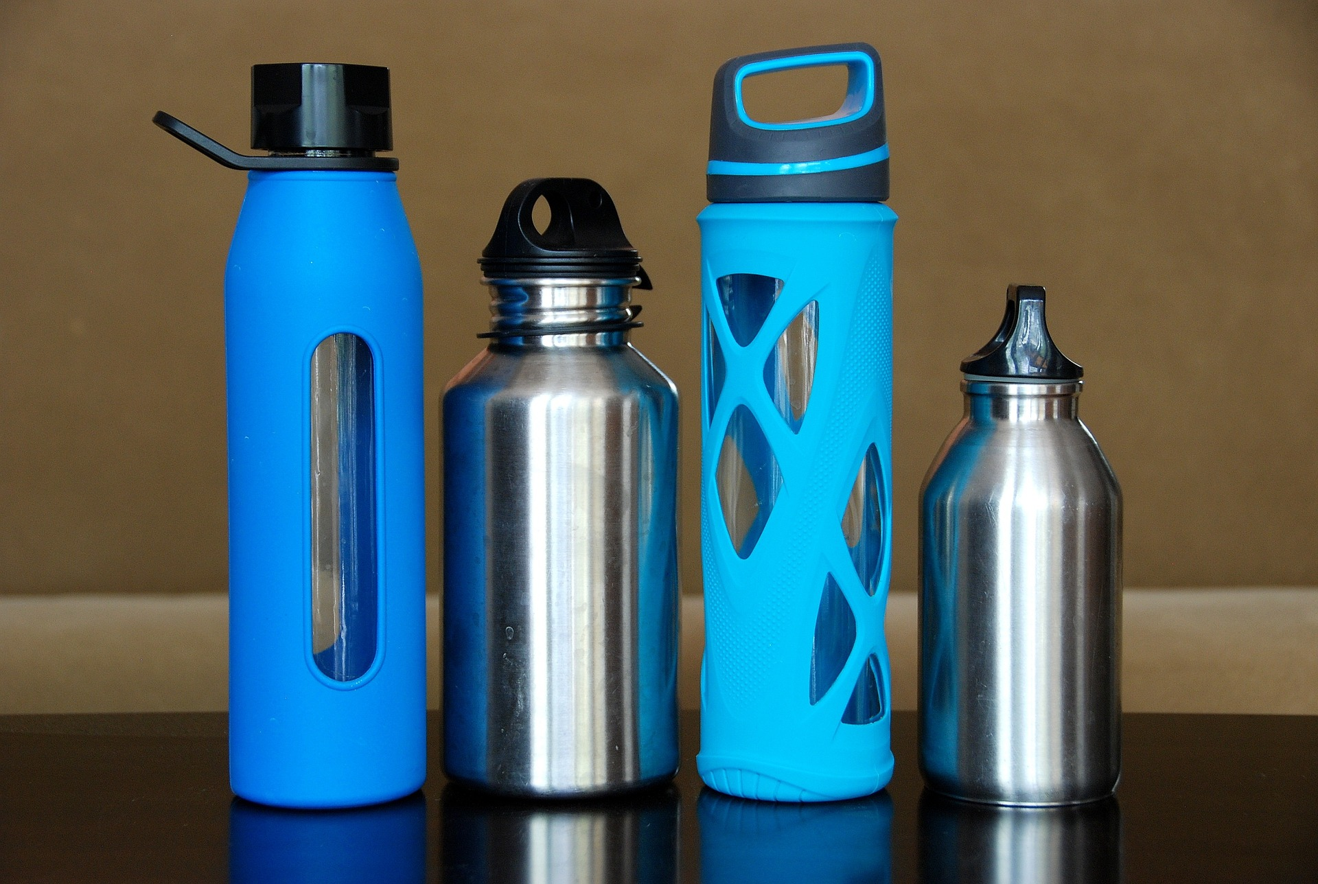 Reusable water bottles or tumblers are a great solution to disposable plastic bottles.