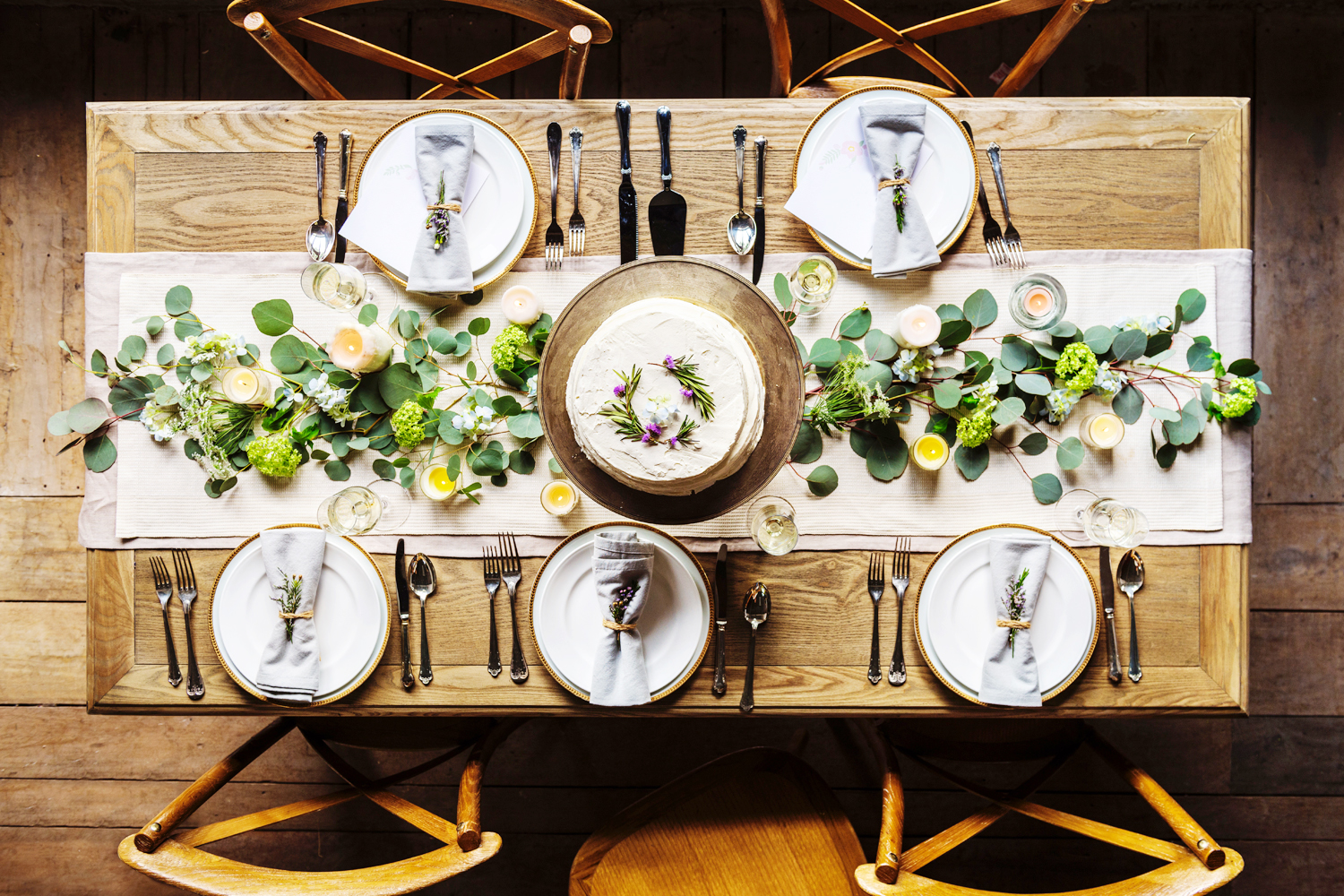 Setting a dinner table with reusable plates and silverware goes a long way to making all your holiday dinners less wasteful and more environmentally friendly.
