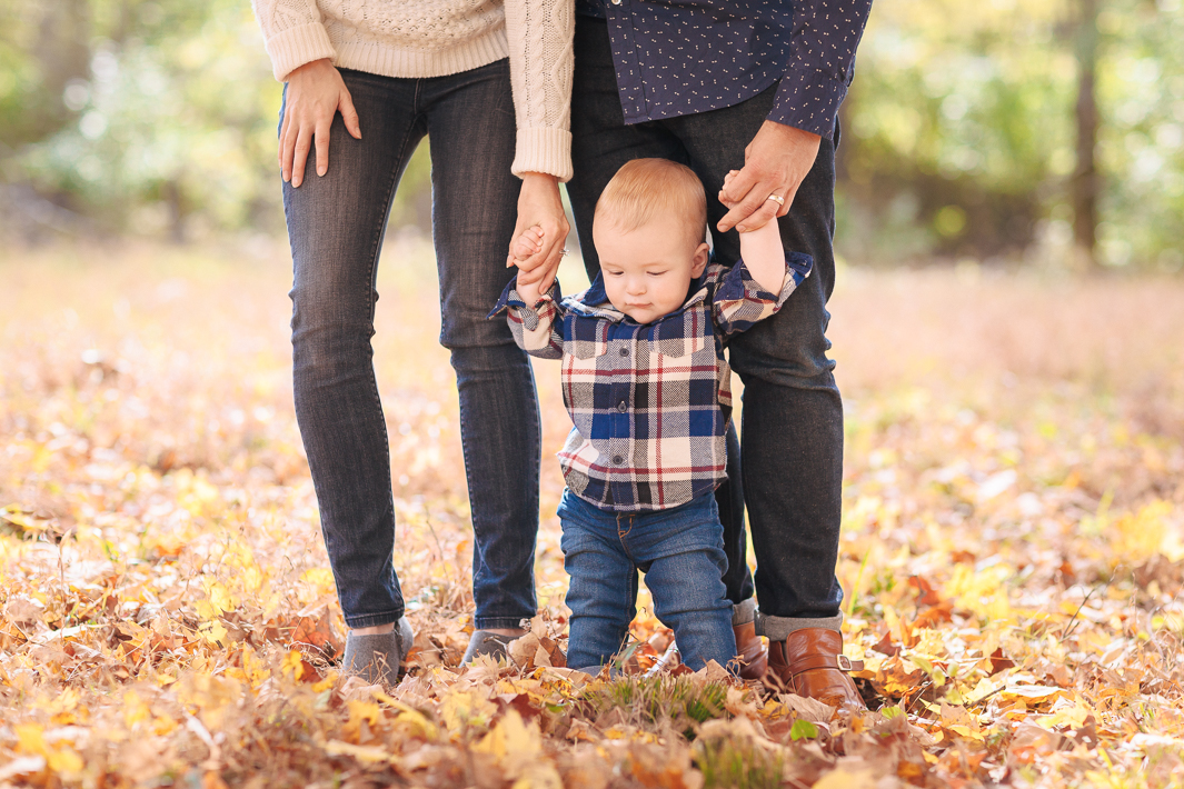 A gentle moment during an autumn family portrait session.