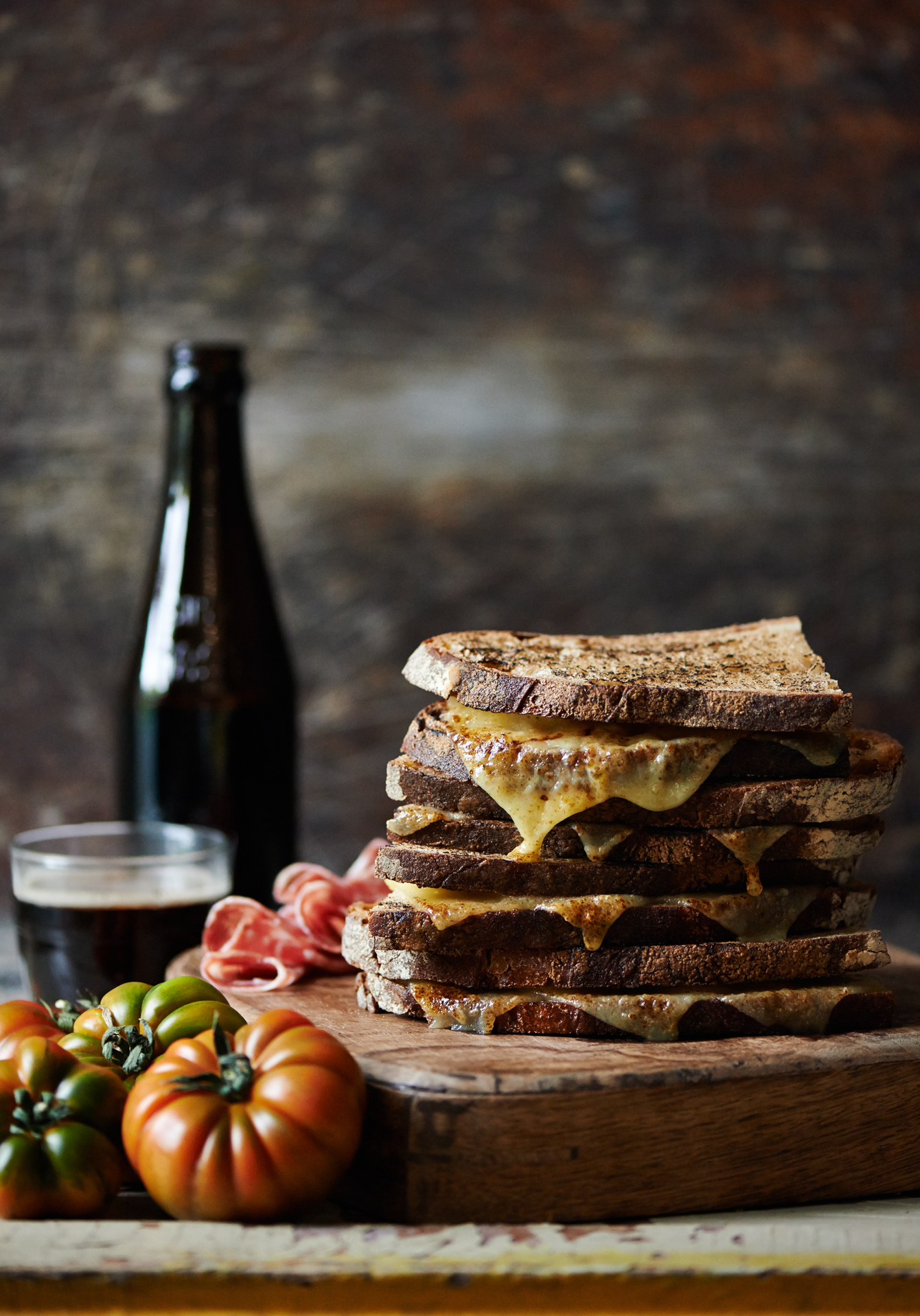 dark food photography of a grilled cheese sandwich