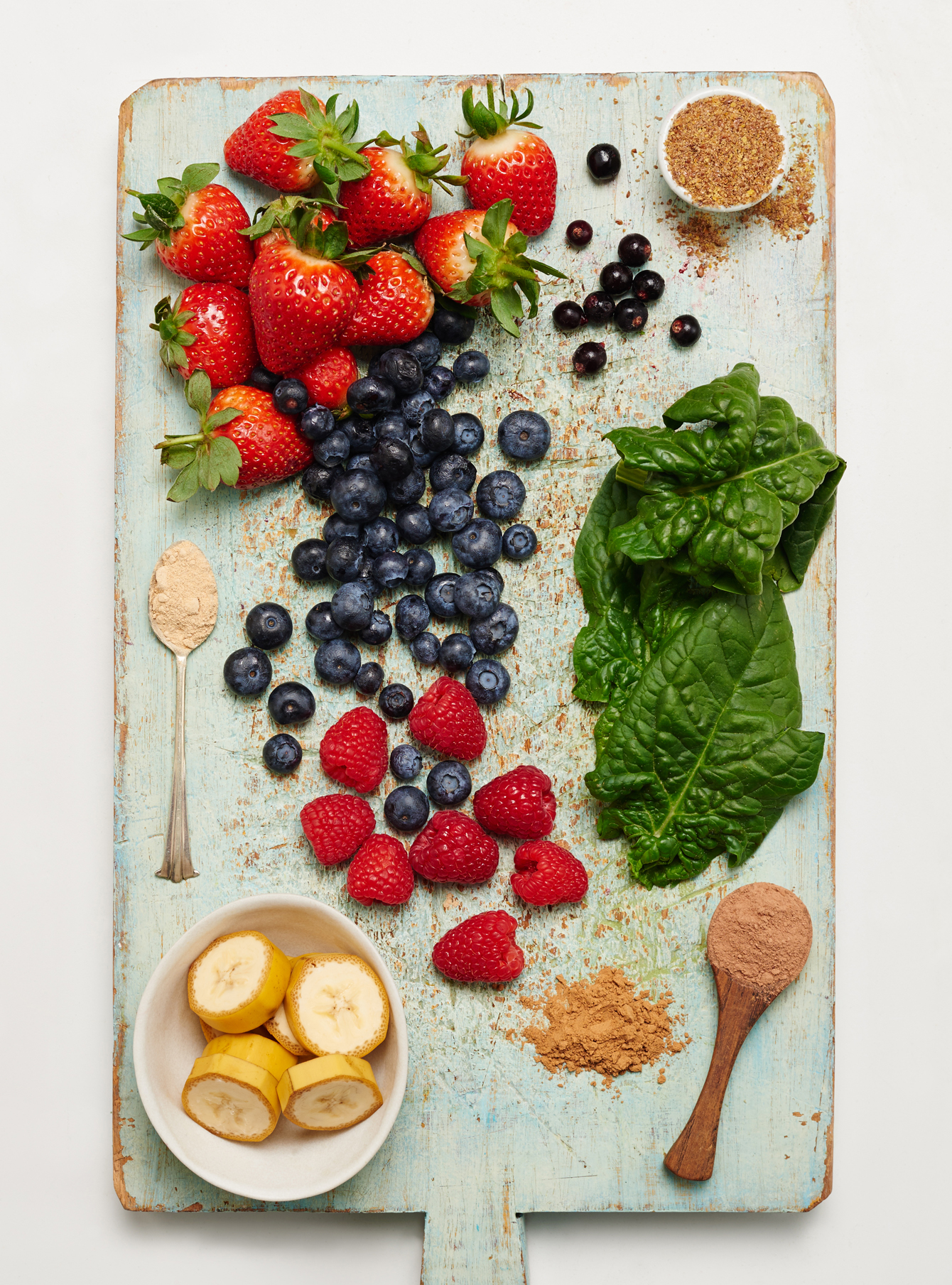chopped fruit and superfood powders flatlay image