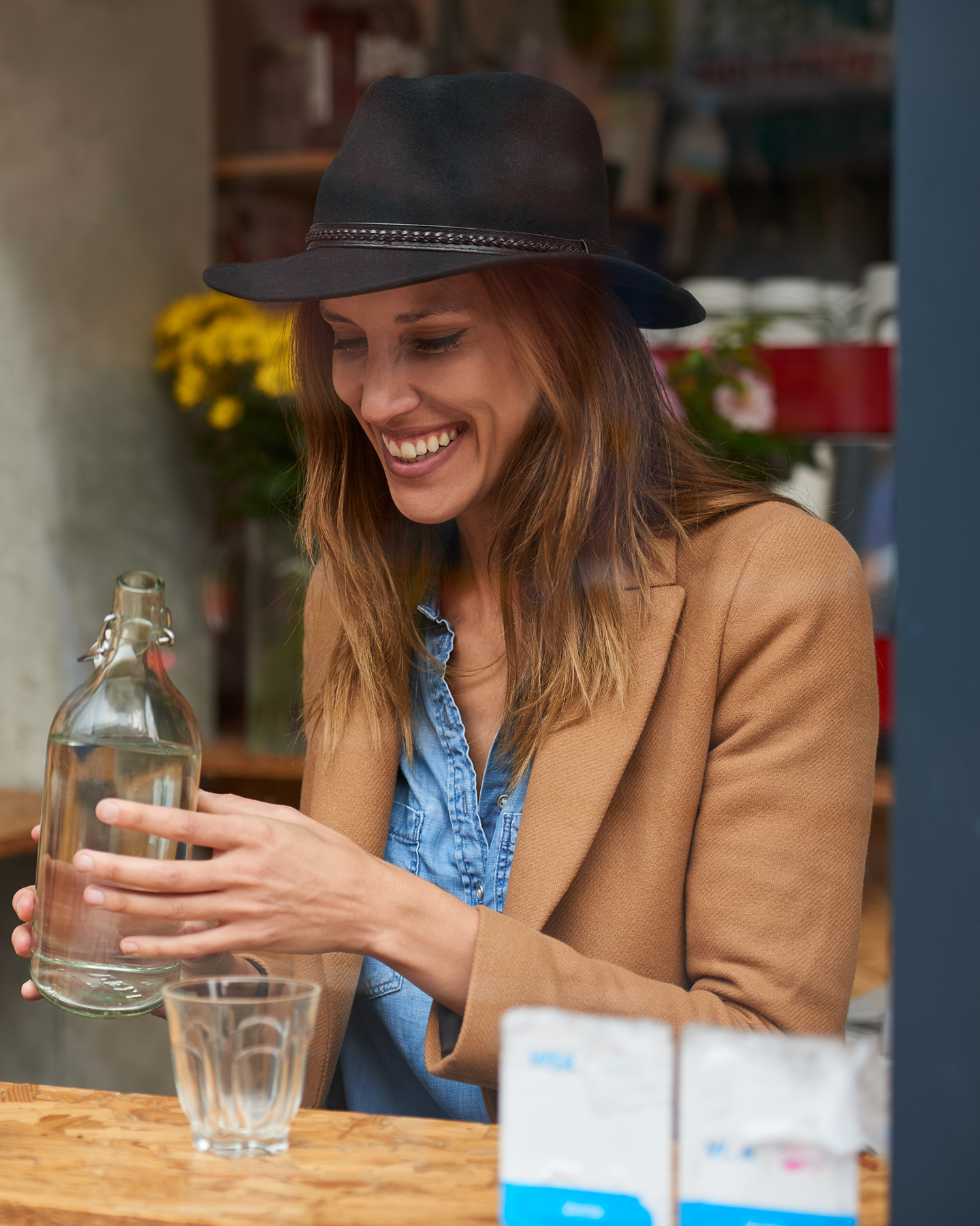 photograph of woman through a cafe window