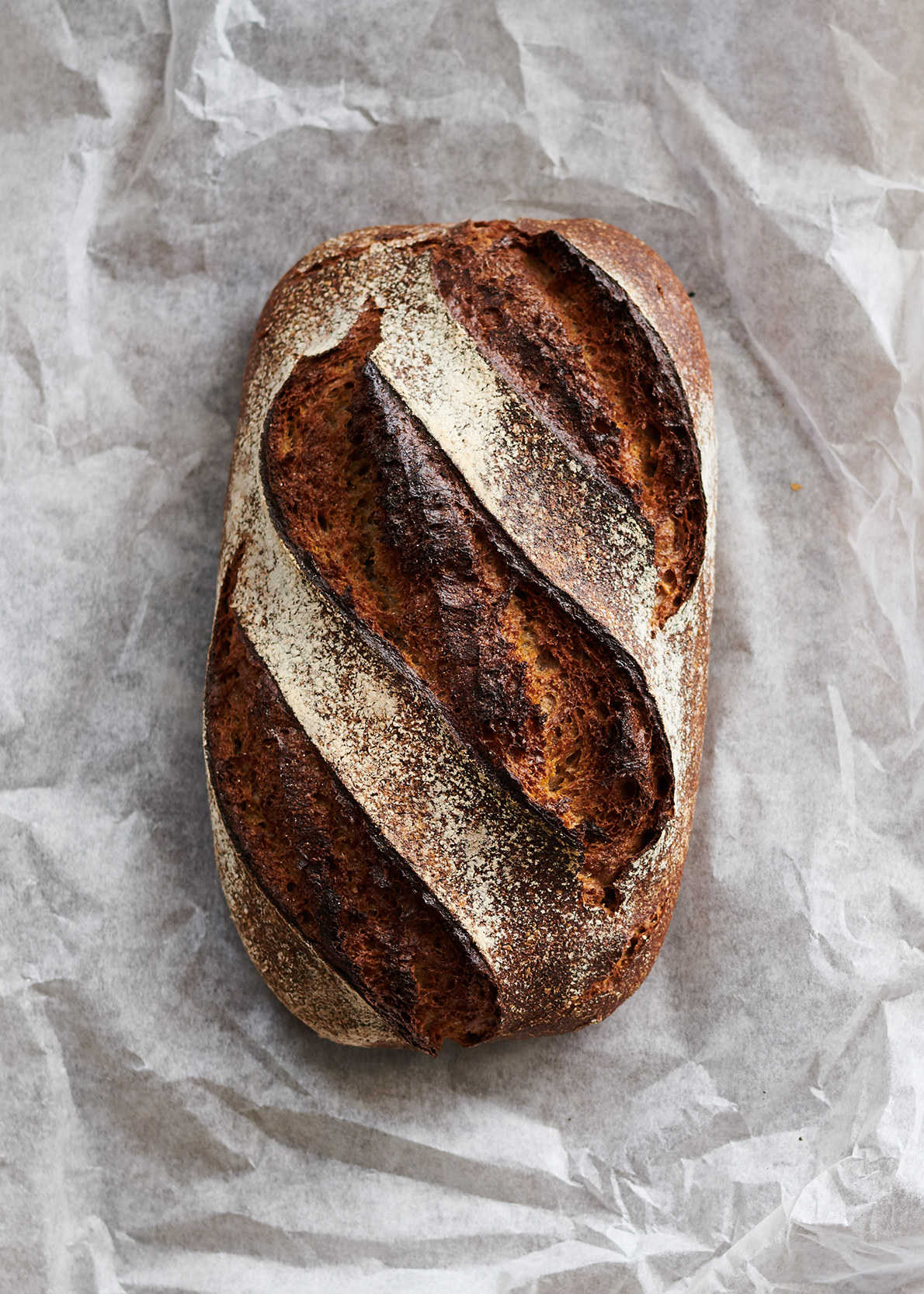 image of a sourdough loaf by food photographer Holly Pickering
