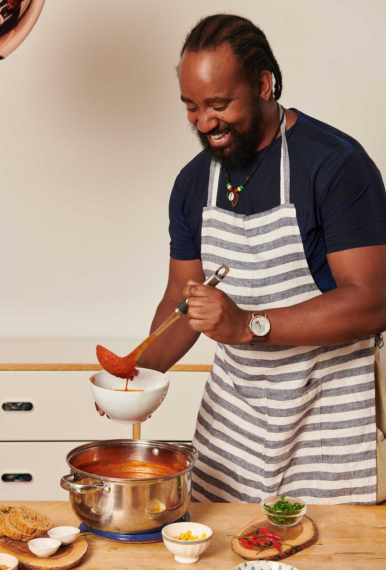 portrait of a man serving soup