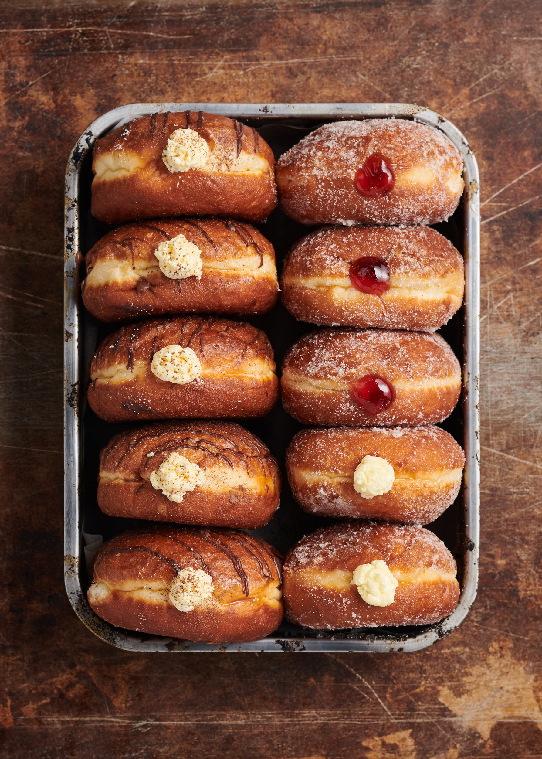 food photography of a box of jam donuts