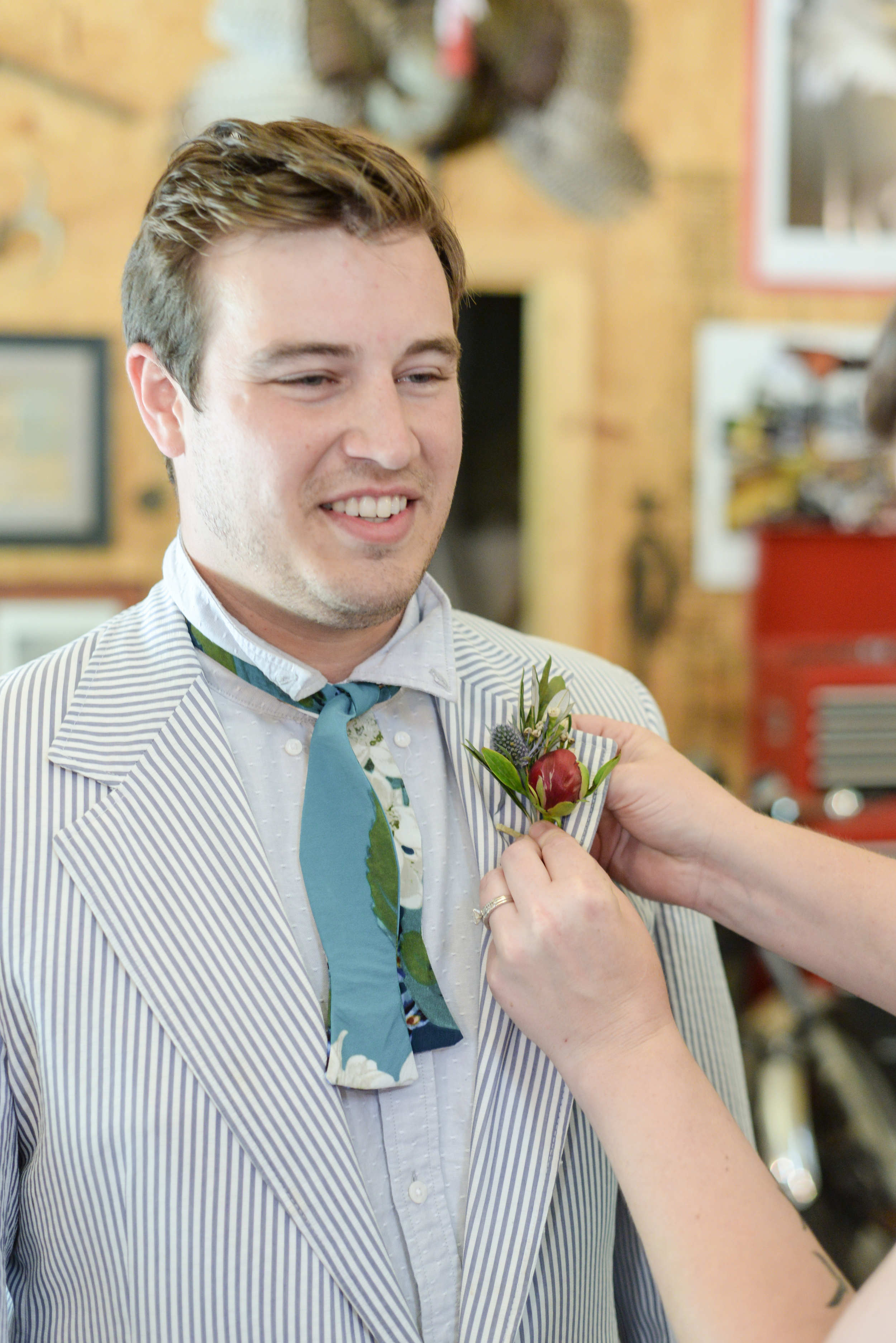 style altard st louis groom boutonnière pinning