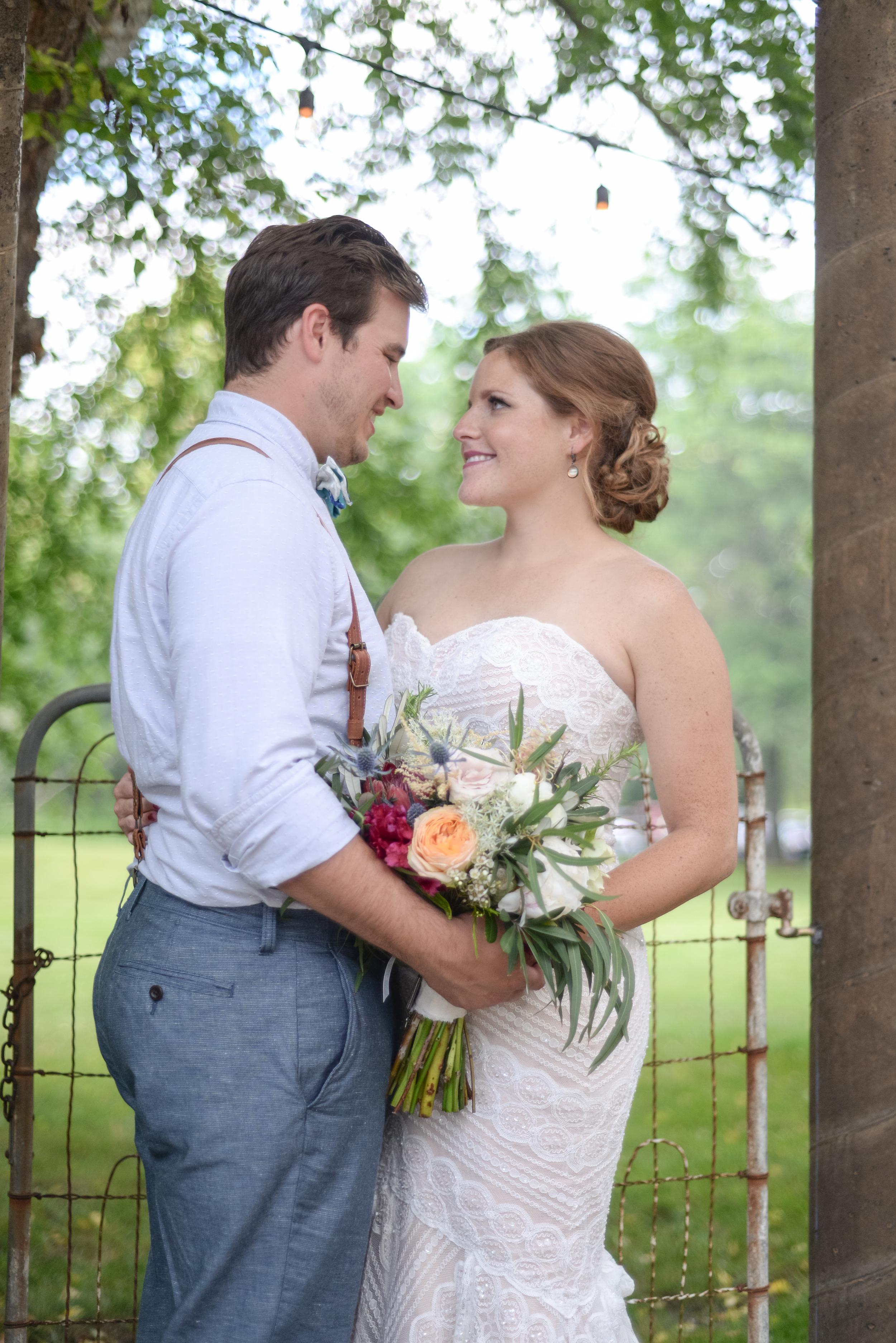 style altard st louis backyard wedding newlyweds