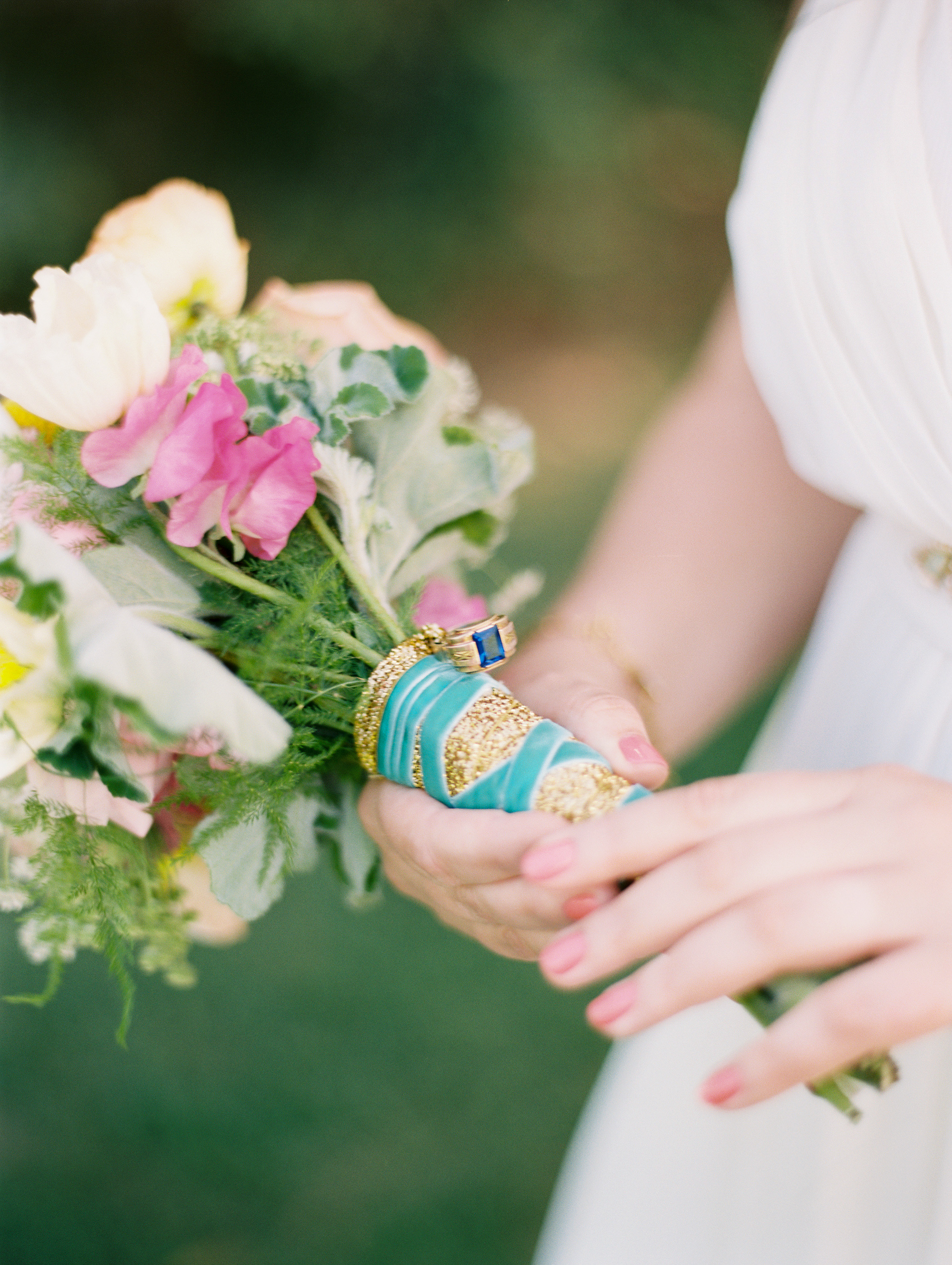 DeFiore Photography  captured this beautiful moment.  This fun and colorful bouquet included a ring from Grandma.
