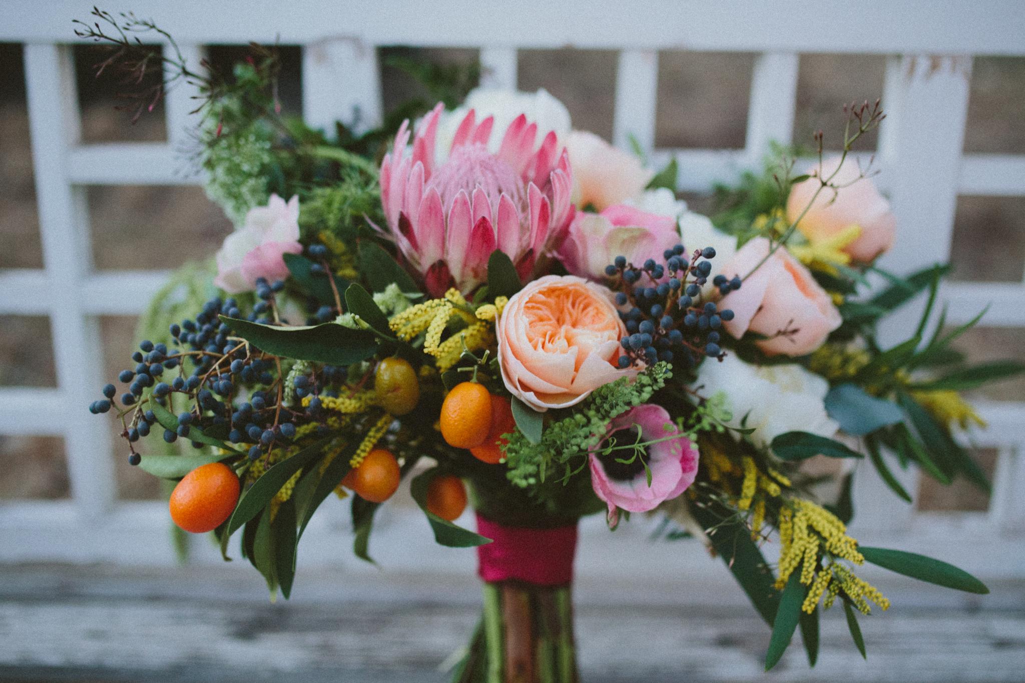 Lace and Lilies, citrus bouquet, protea, kumquats