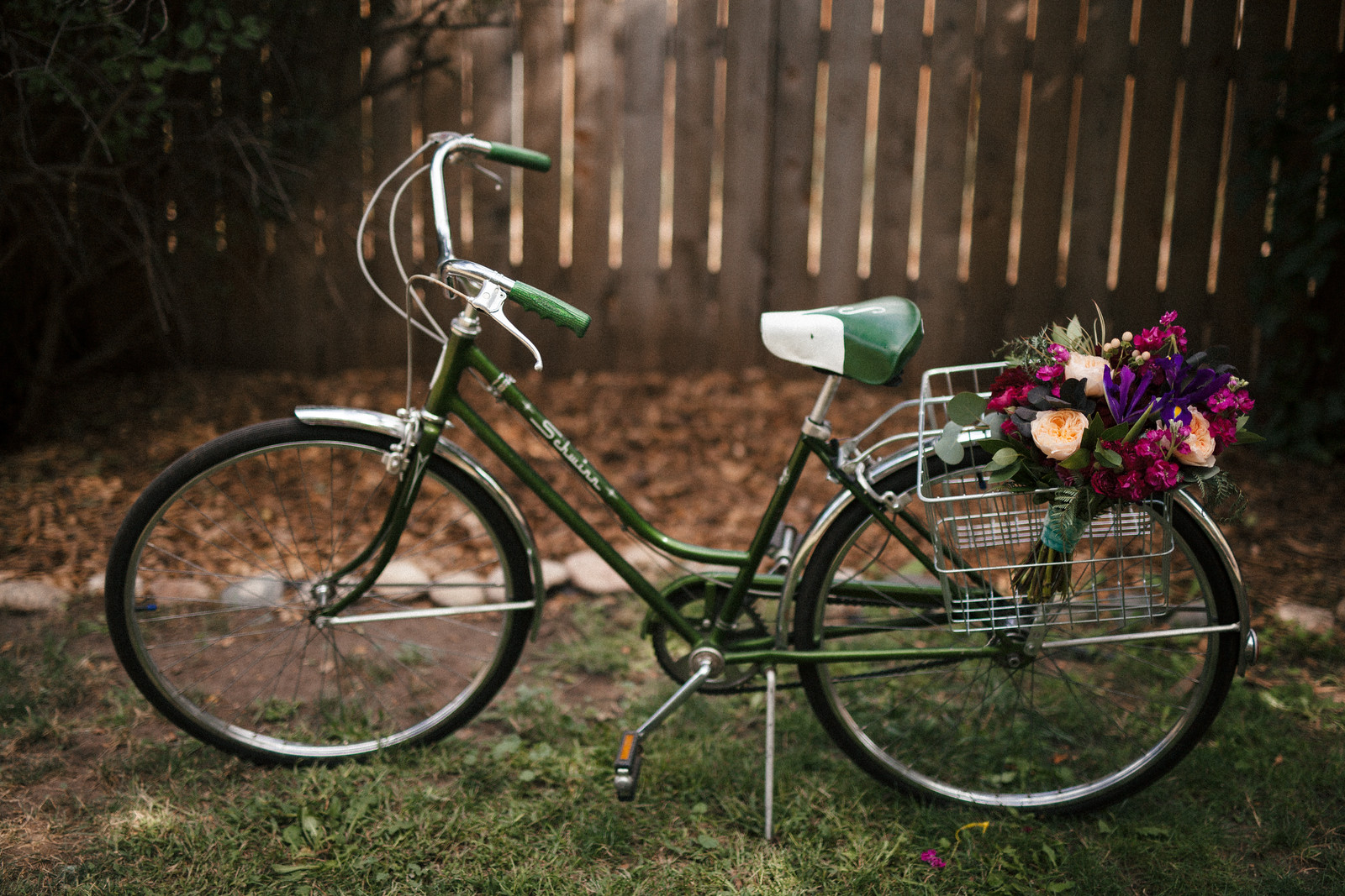 Jewel tone wedding bouquet, bicycle basket