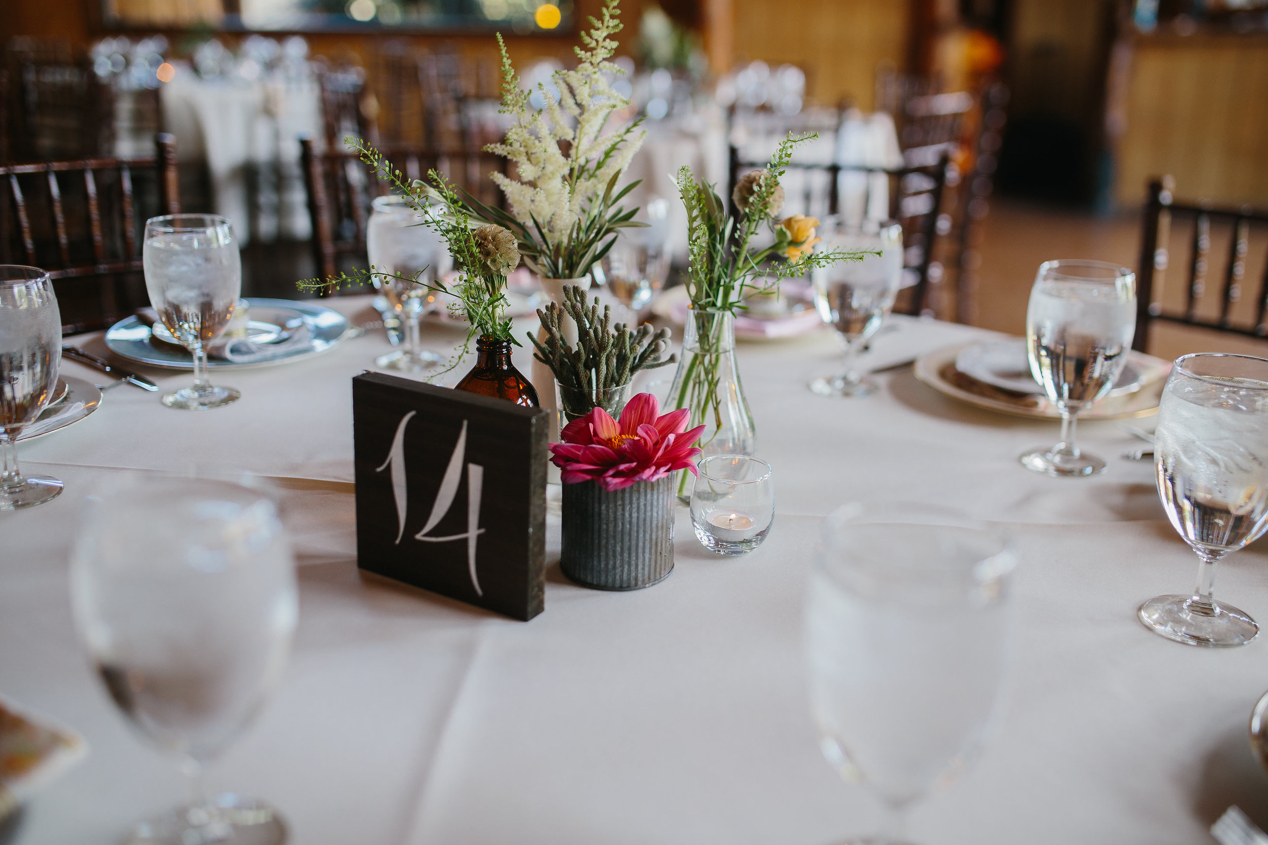 Flowers by Lace and Lilies - colorful eclectic centerpiece arrangements, pink, coral, bride, orange, foliage, table number, summer wedding, fun, colorado, spruce mountain ranch