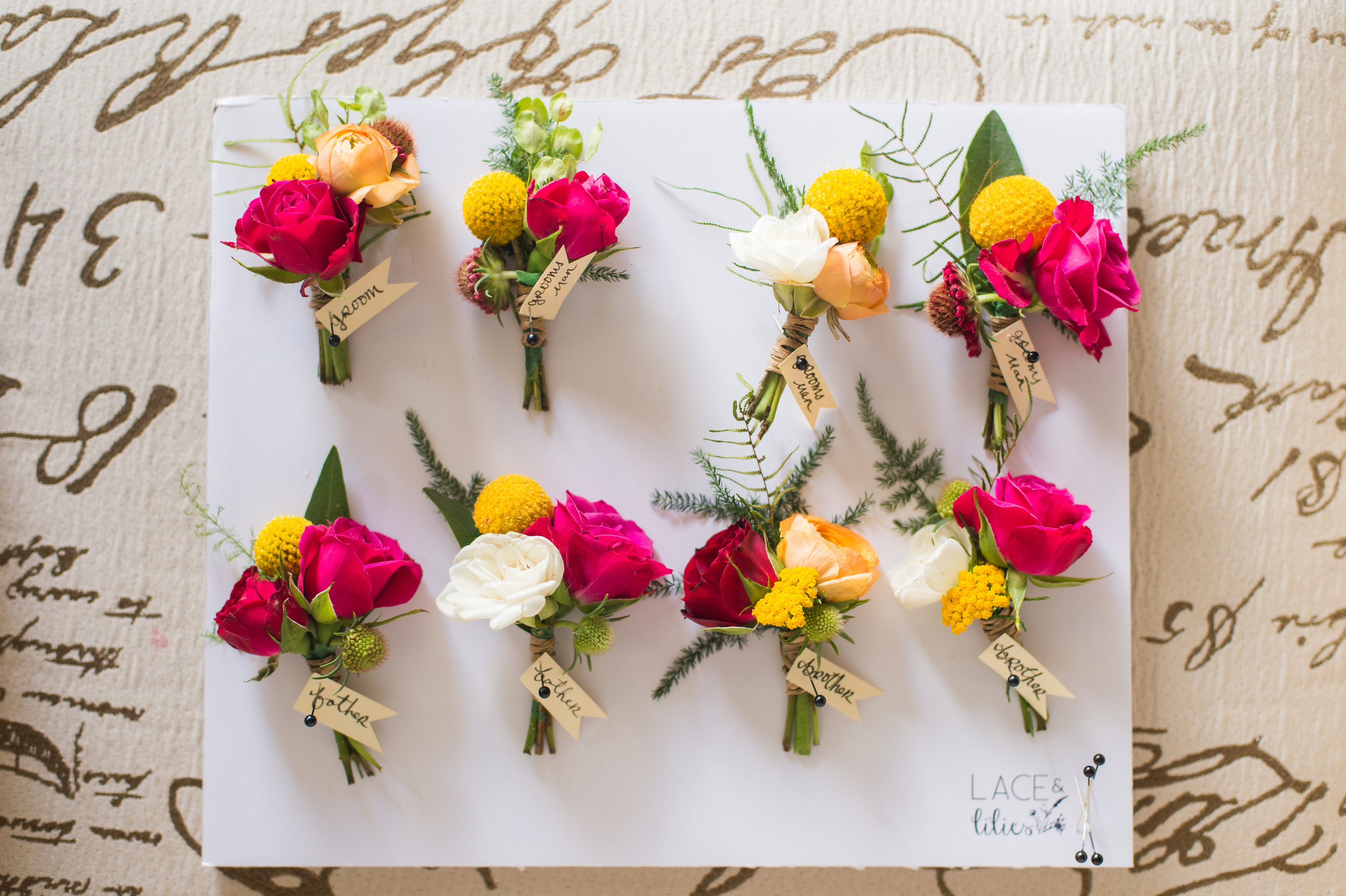 Flowers by Lace and Lilies, bright and bold summer boutonnieres, spray rose, ranunculus, fern and billy balls