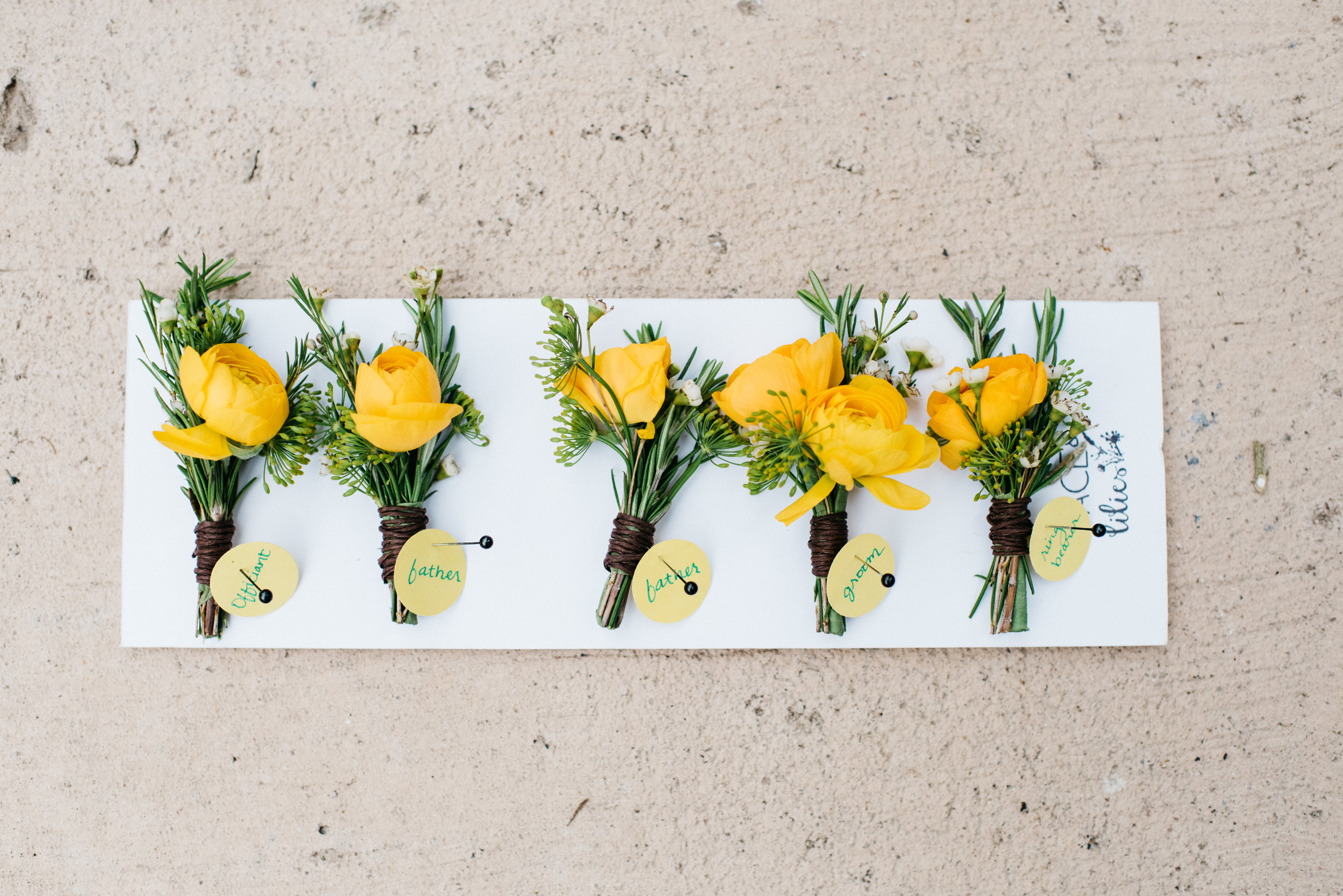 Flowers by Lace and Lilies, yellow ranunculus and herb boutonnieres, summer bright and bold flowers