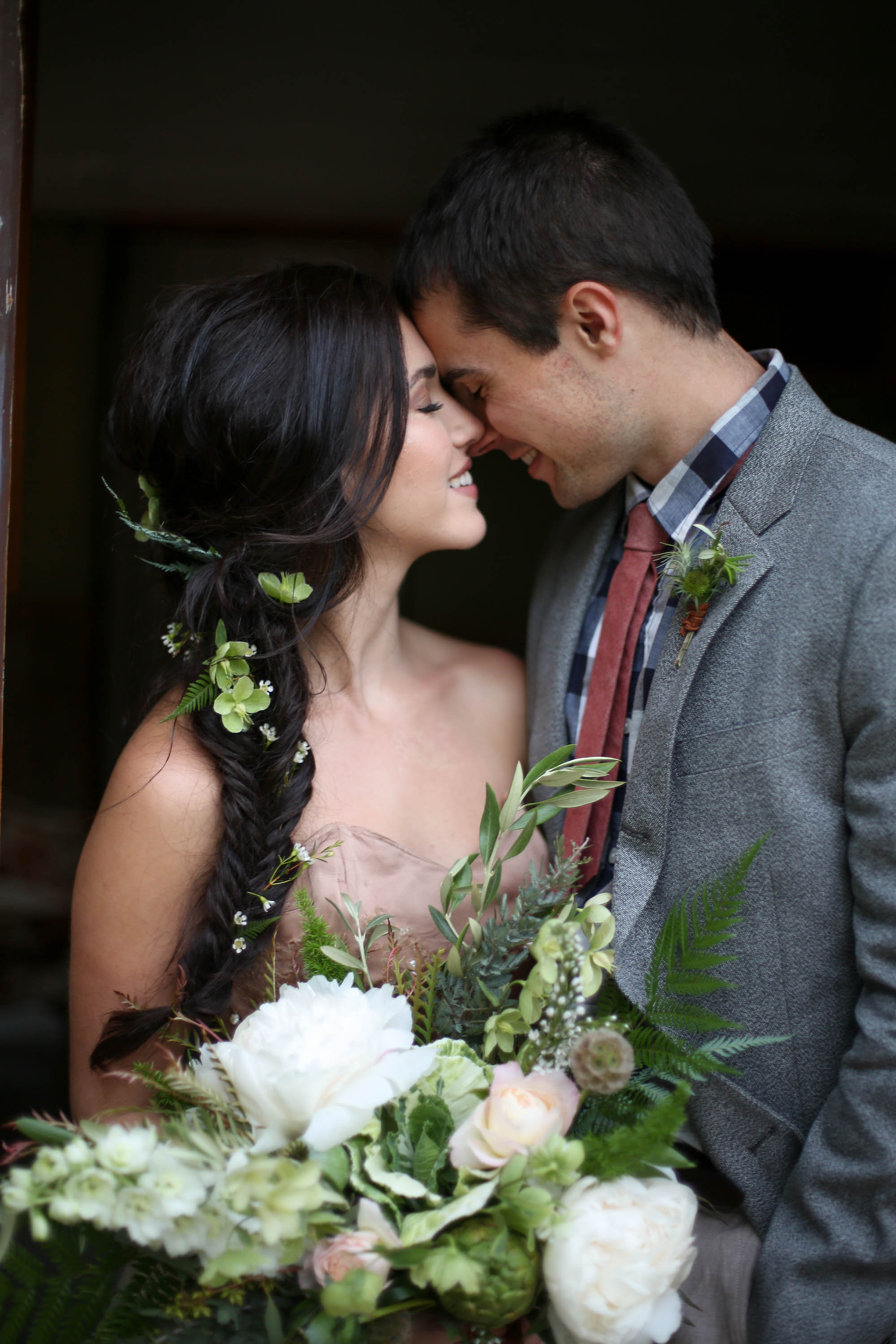 Flowers by Lace and Lilies, green foliage and white peony wedding, mountain rustic boutonniere with leather wrap