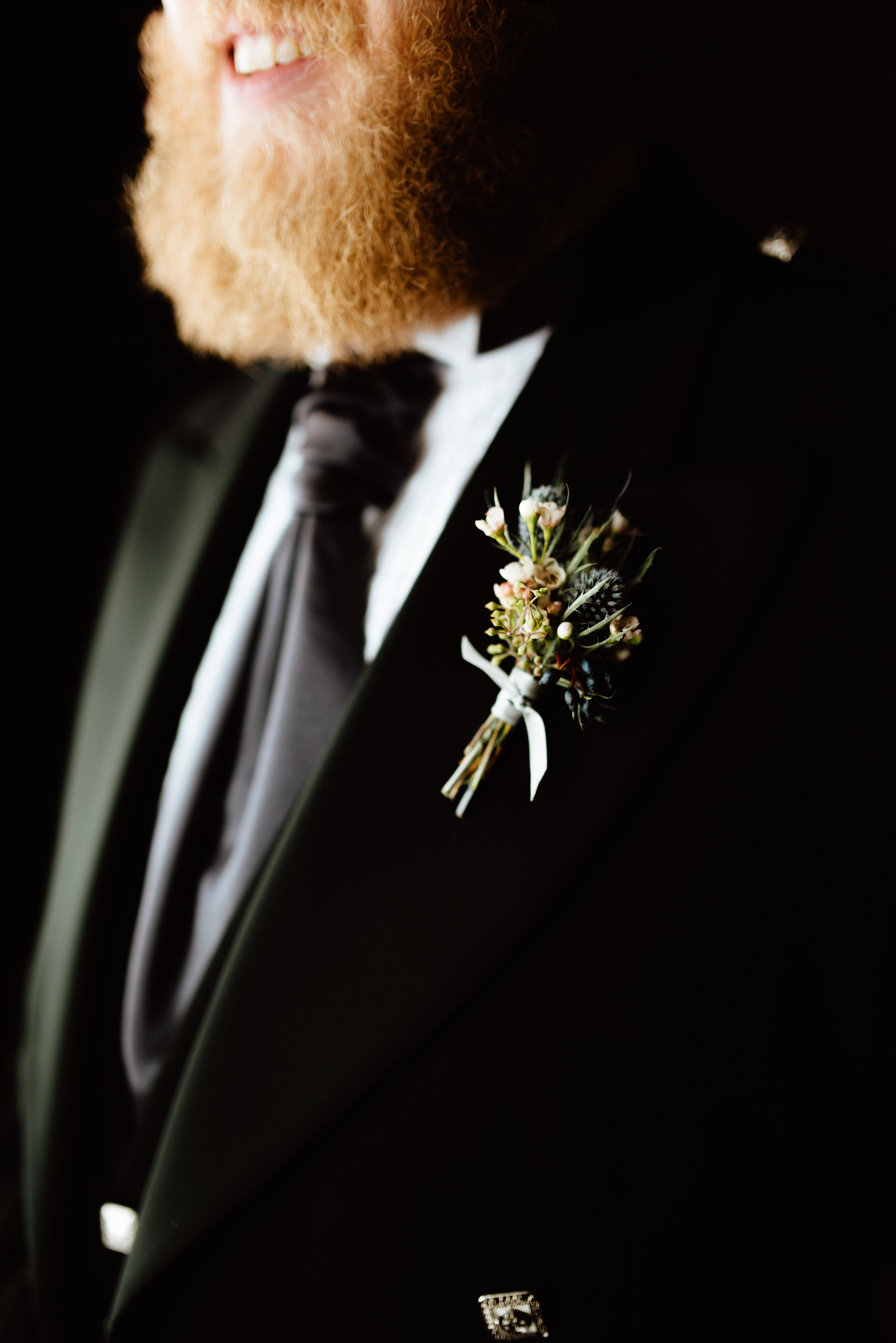 Flowers by Lace and Lilies, blue thistle and wax flower boutonniere - black tie wedding