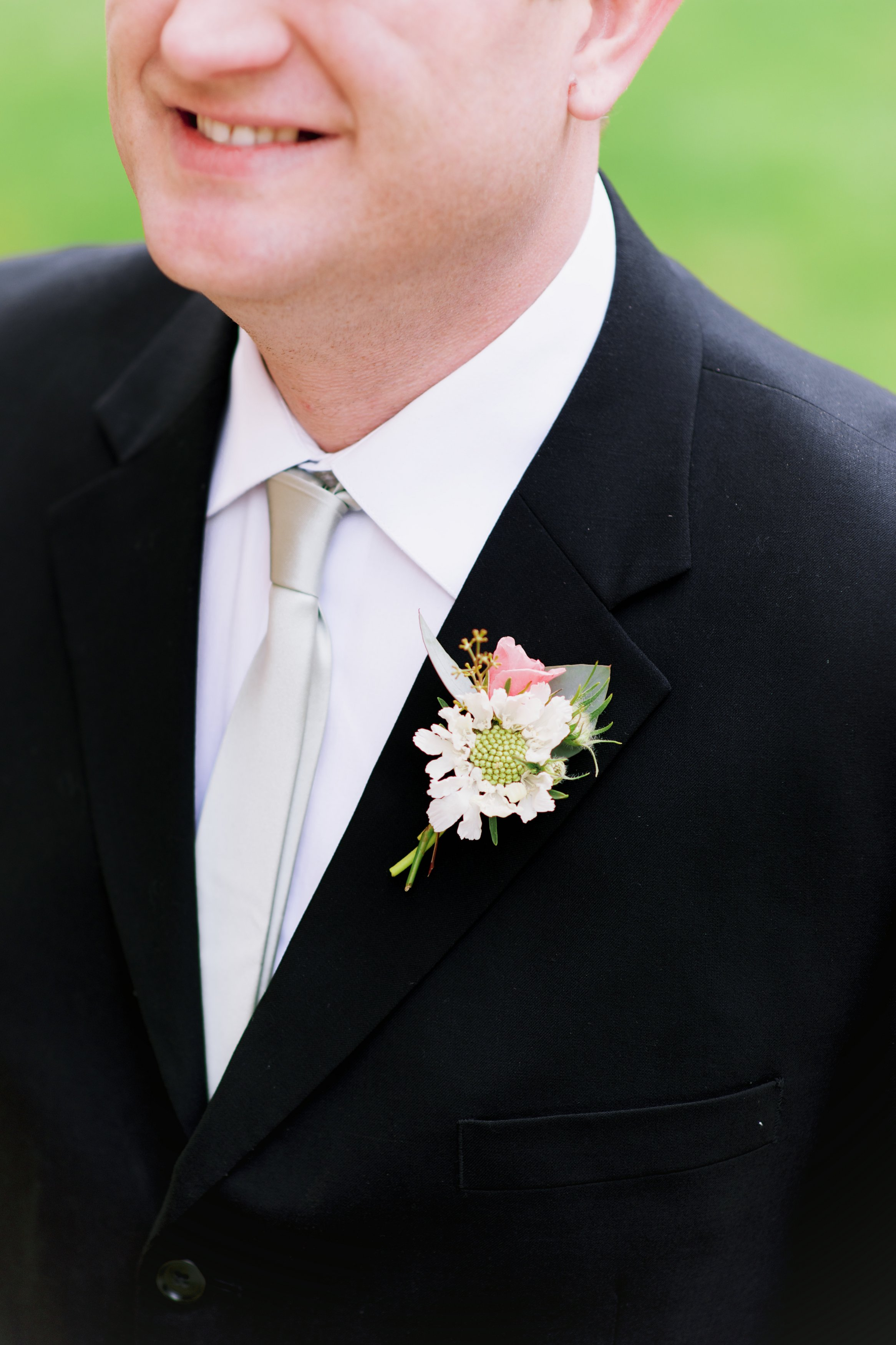 Flowers by Lace and Lilies, white scabiosa and pink spray rose boutonniere. Black tie wedding